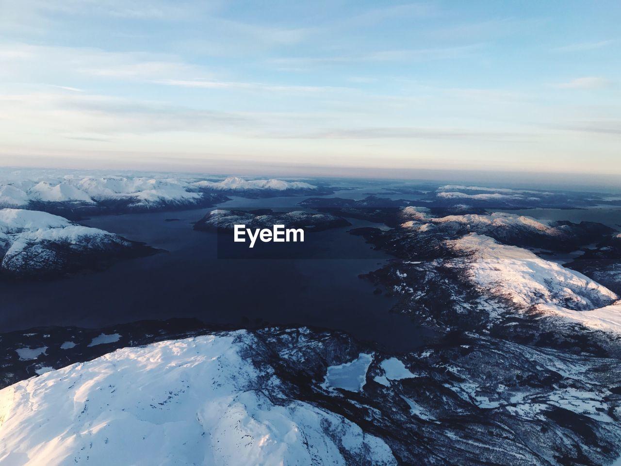 Aerial View Of Frozen Landscape Against Sky