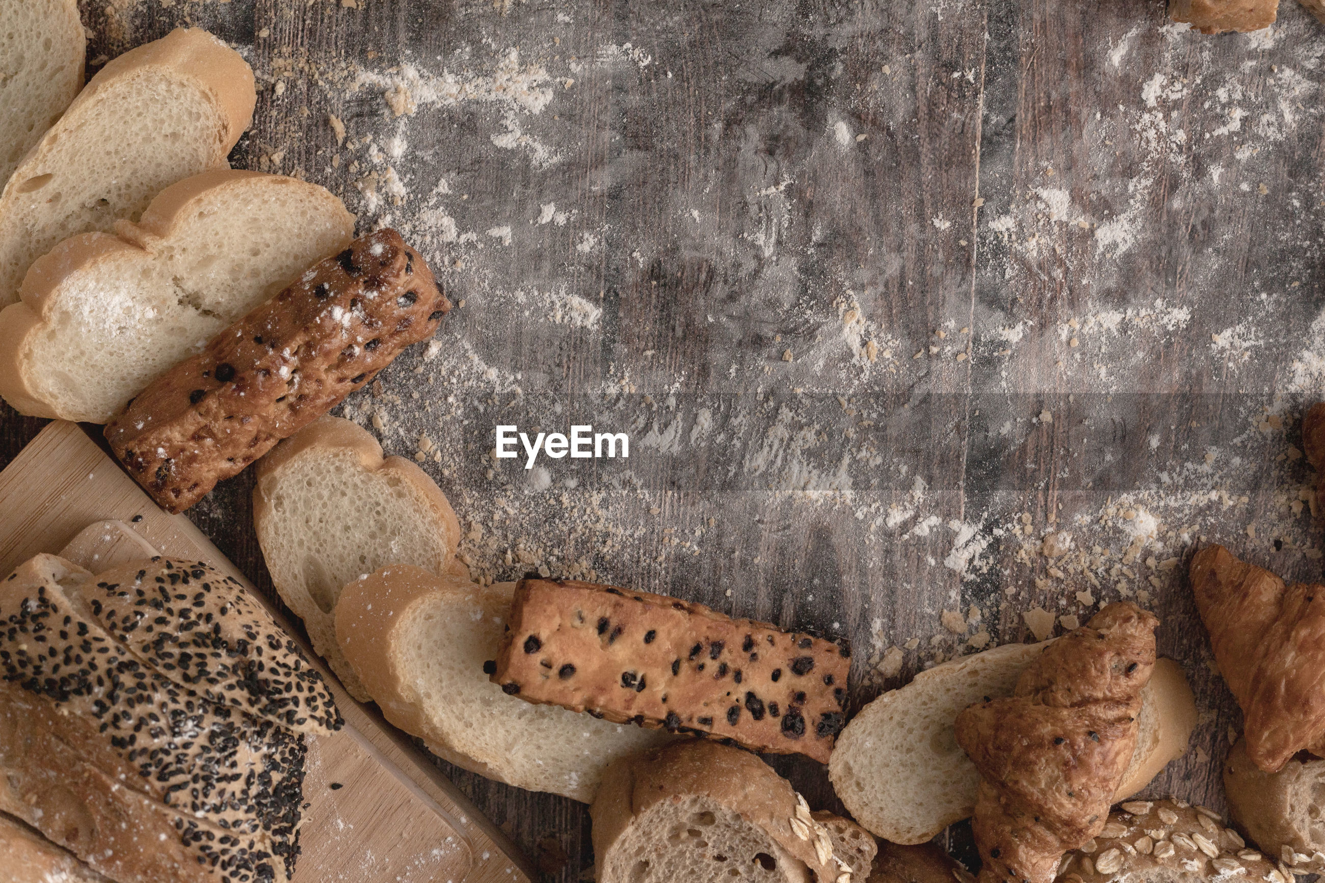 Breads and pastry flour on a wooden table and copy space for text input
