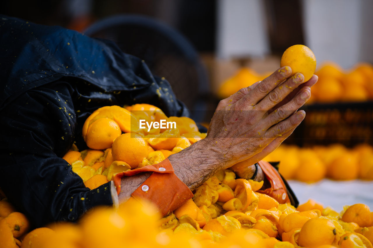 Person Praying In Thrown Oranges