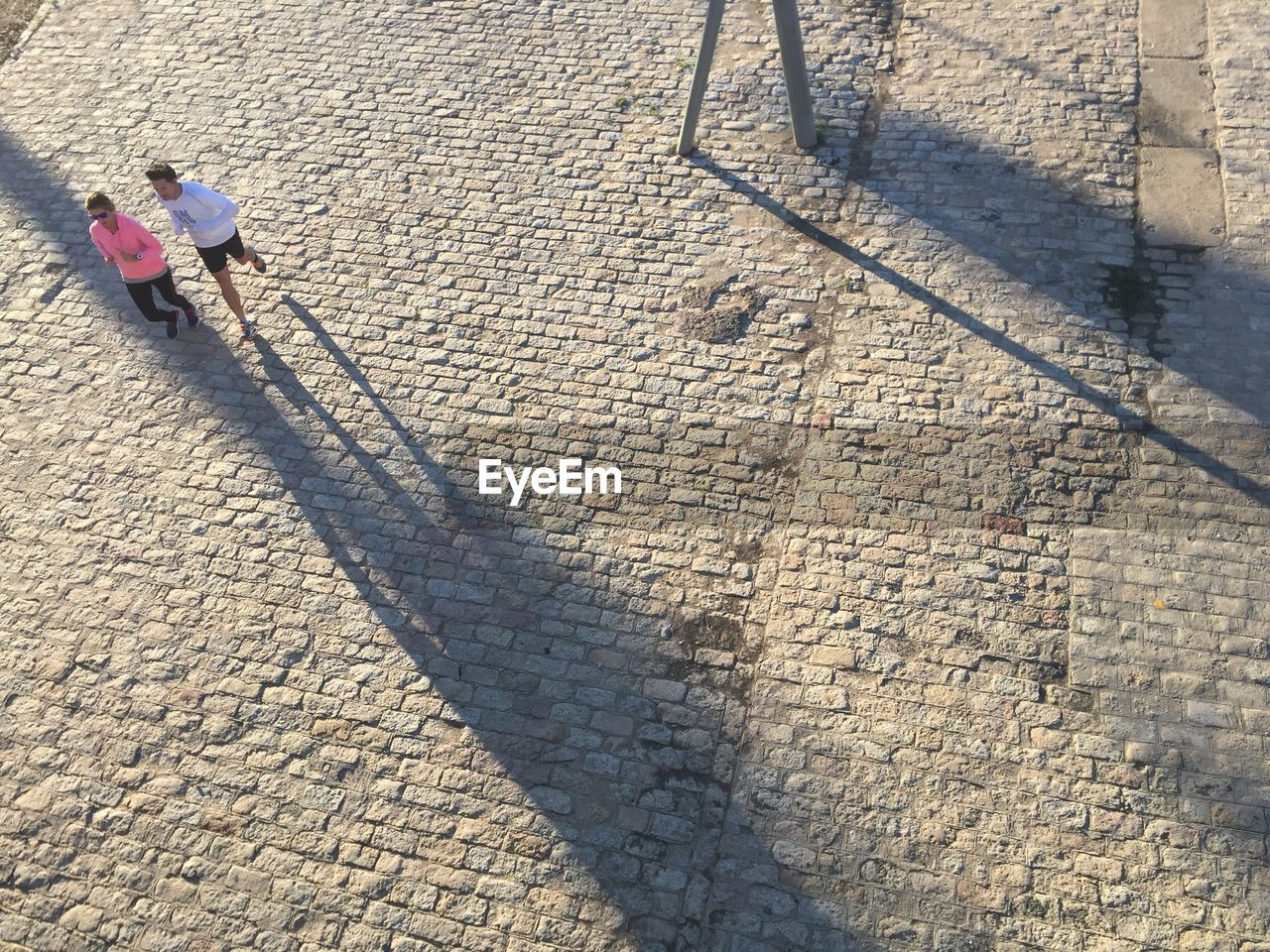 shadow, high angle view, two people, sunlight, outdoors, day, togetherness, full length, men, real people, sand, childhood, working, adult, people, adults only, only men