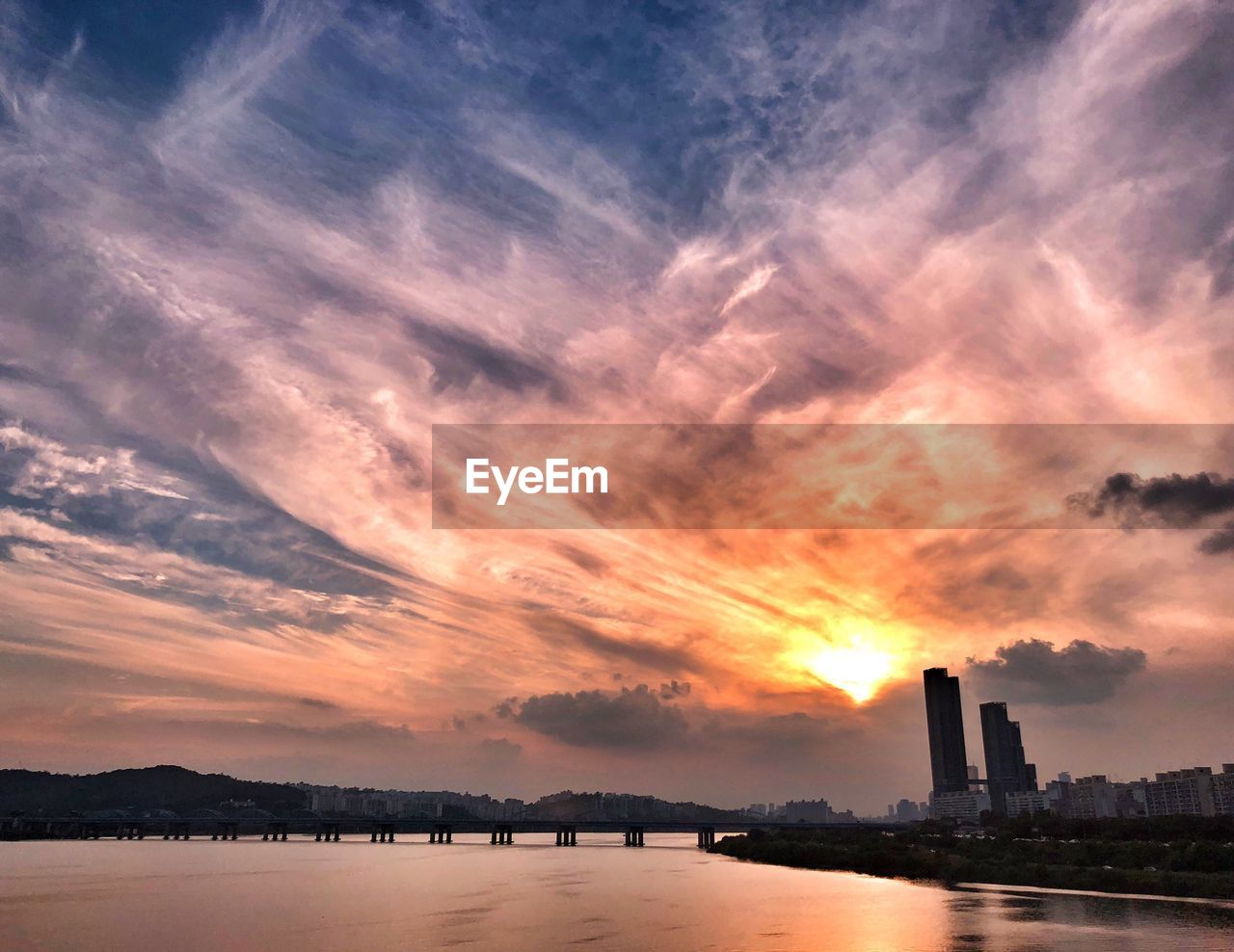 sky, cloud - sky, sunset, architecture, built structure, building exterior, water, waterfront, nature, beauty in nature, orange color, no people, scenics - nature, building, tower, city, outdoors, river, skyscraper, office building exterior