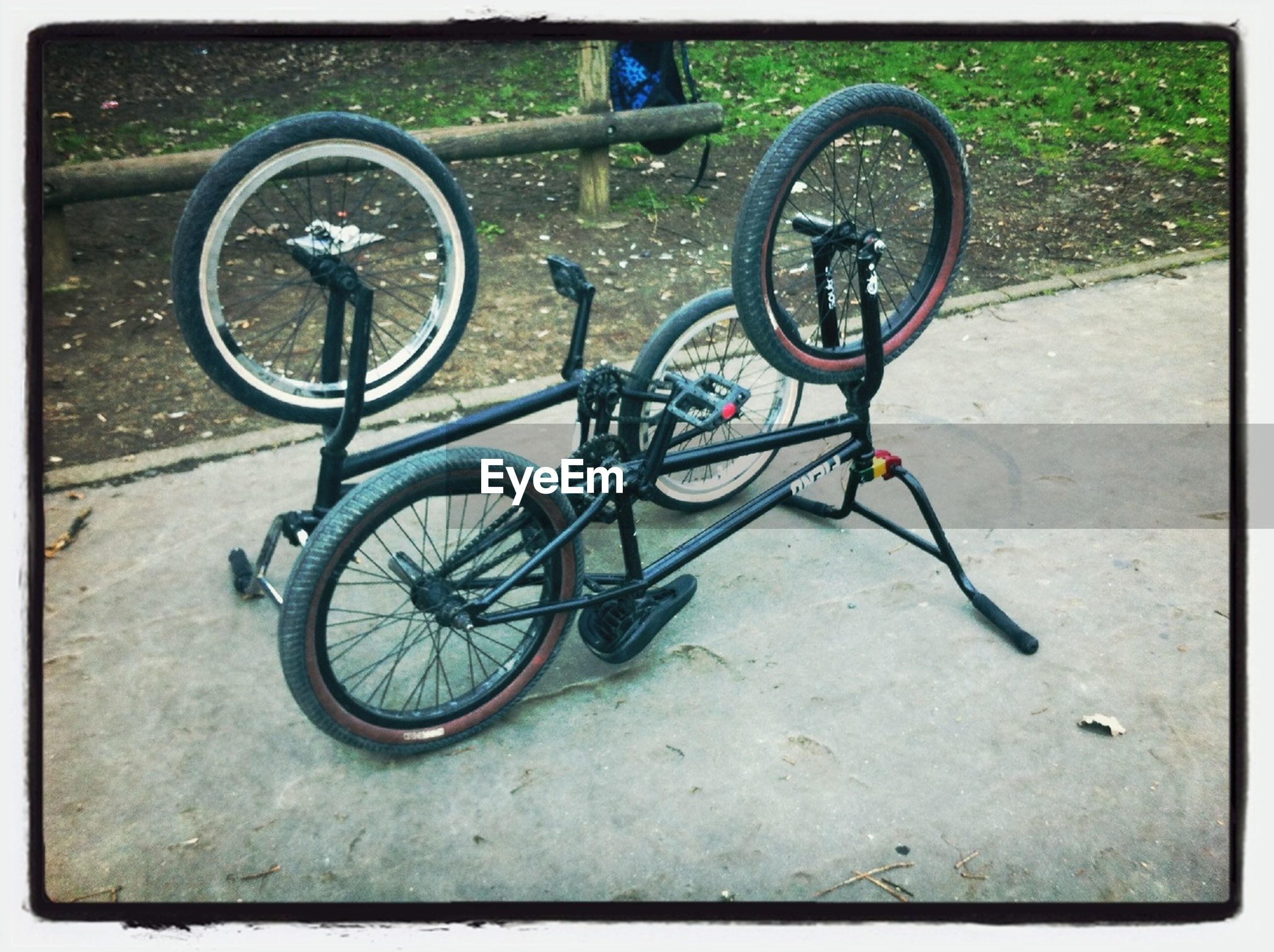 bicycle, transportation, mode of transport, land vehicle, transfer print, stationary, wheel, parking, auto post production filter, parked, street, road, day, outdoors, tire, no people, sunlight, shadow, asphalt, cycle