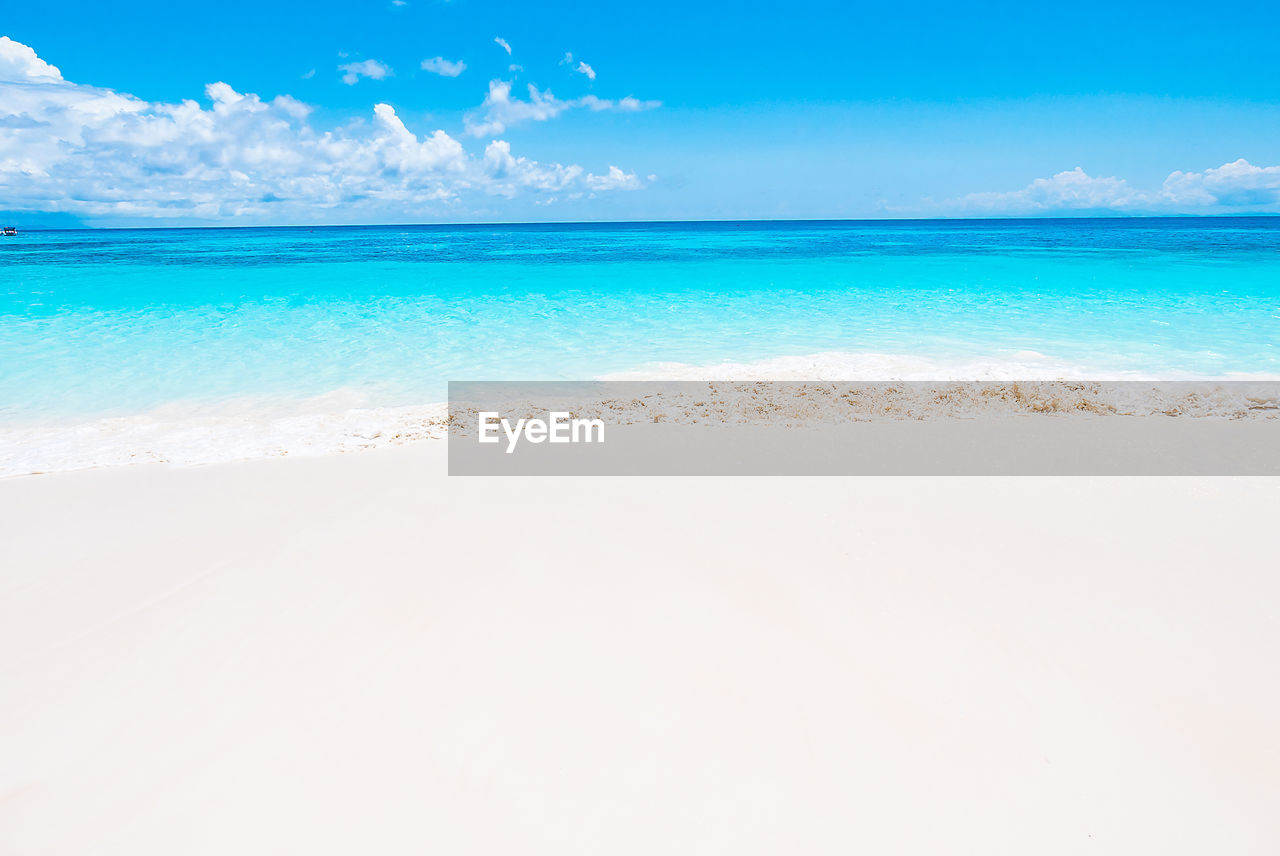 sea, beach, sky, beauty in nature, nature, sand, scenics, water, horizon over water, tranquility, tranquil scene, blue, day, outdoors, cloud - sky, no people