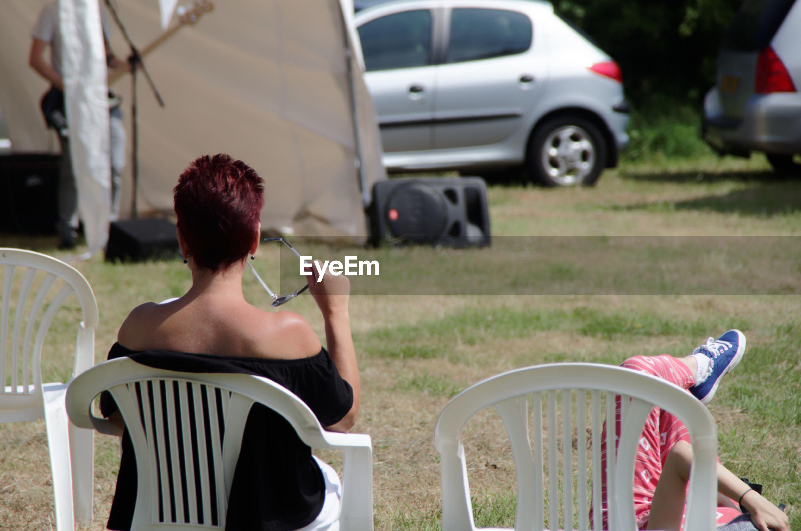 People enjoying music while resting outdoors