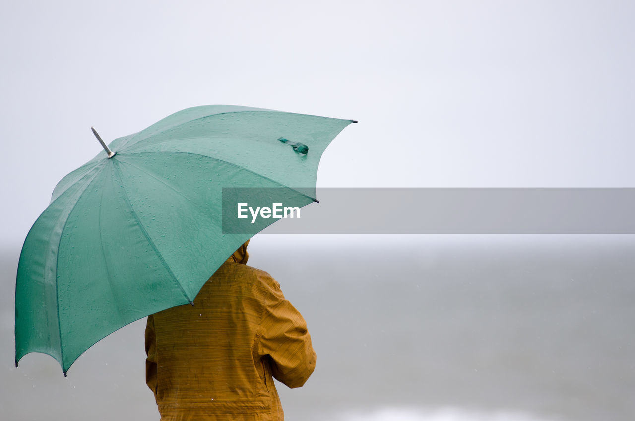 Close-Up Of Person Holding Umbrella