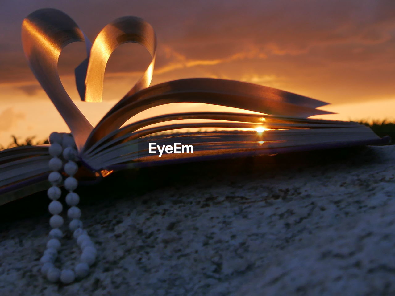 sunset, page, education, book, heart shape, rock - object, love, wisdom, beauty in nature, nature, no people, outdoors, sky, close-up