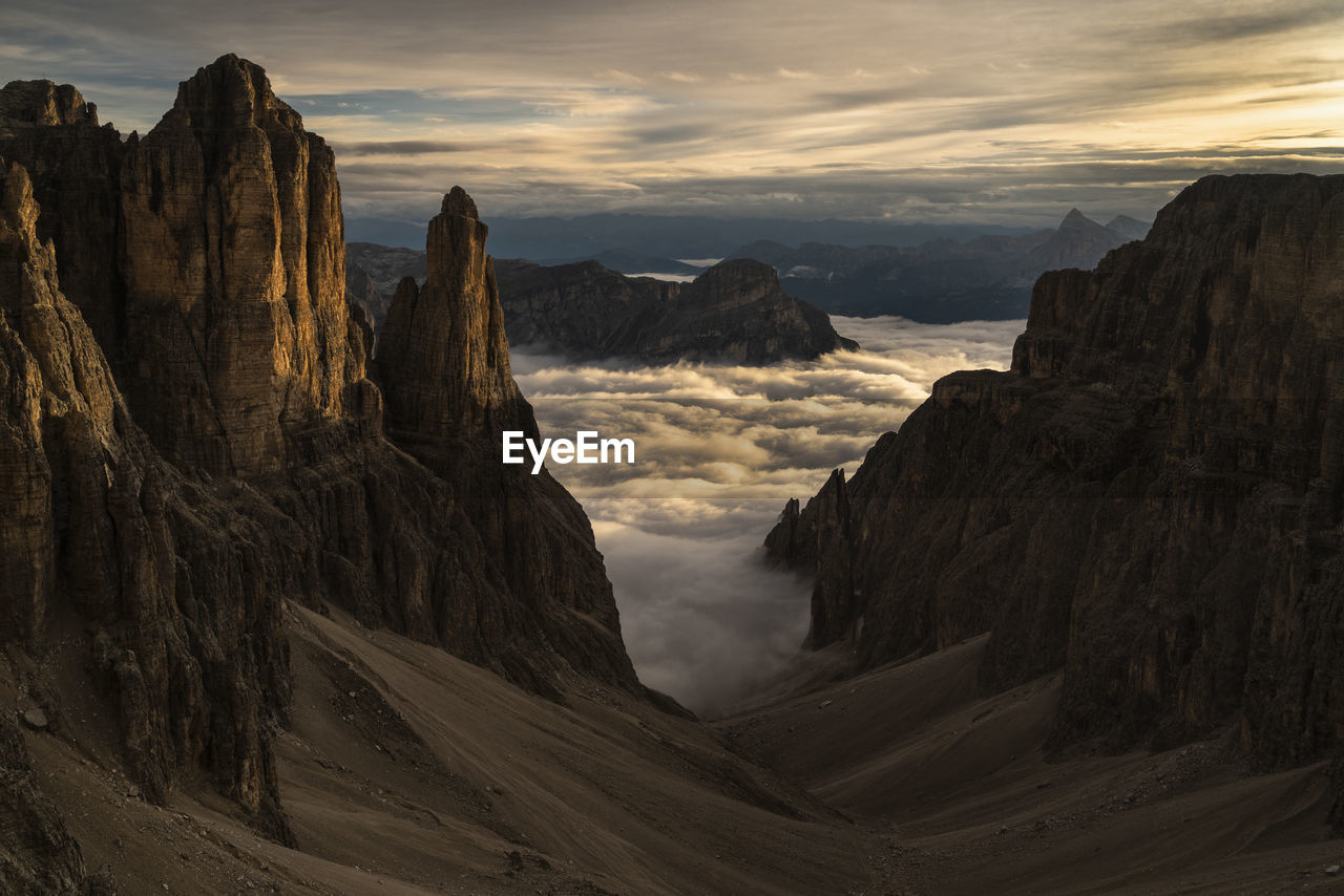 Scenic View Of Mountains Amidst Cloud Sky