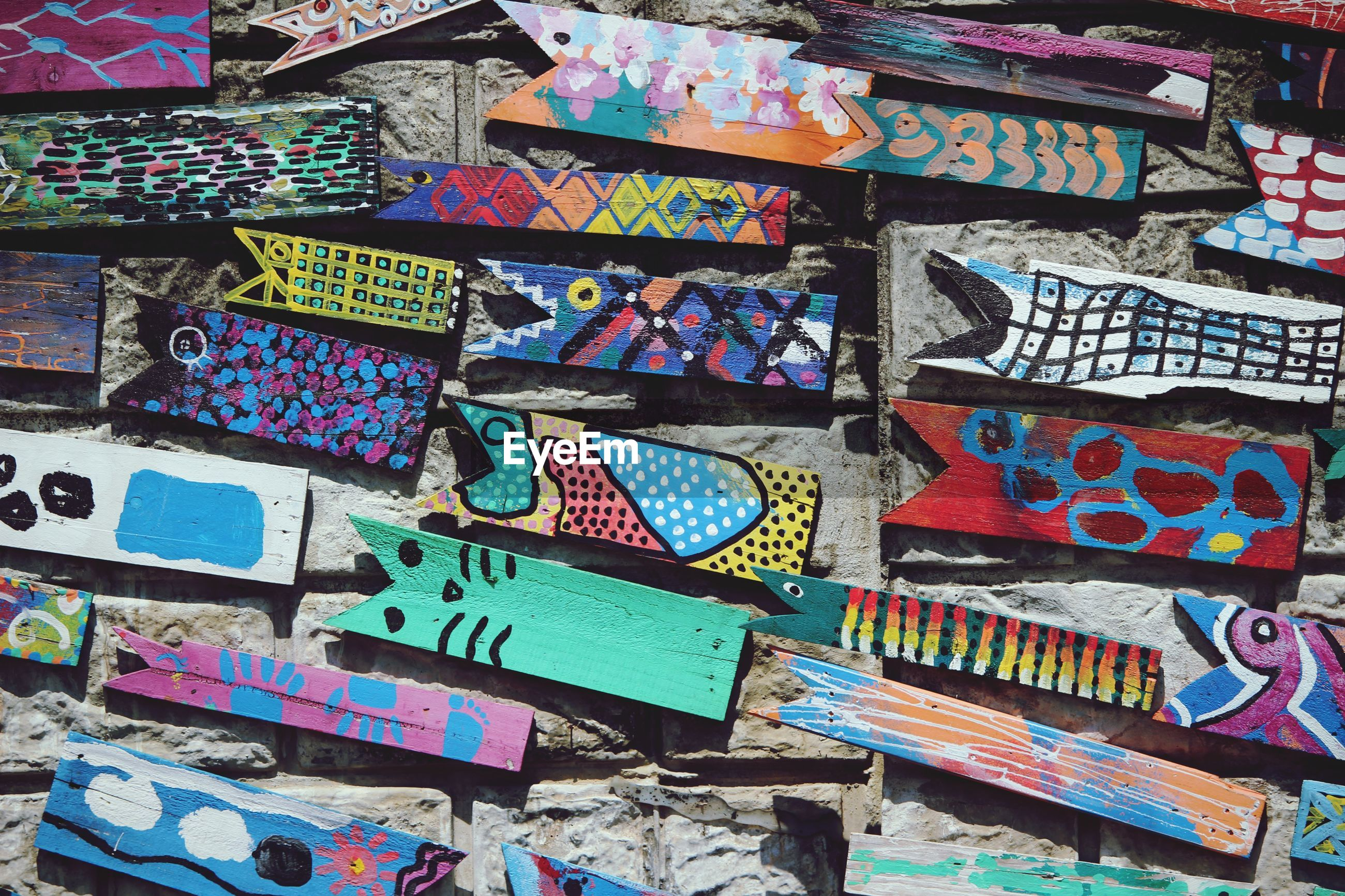 Full frame shot of various colorful wooden planks on wall