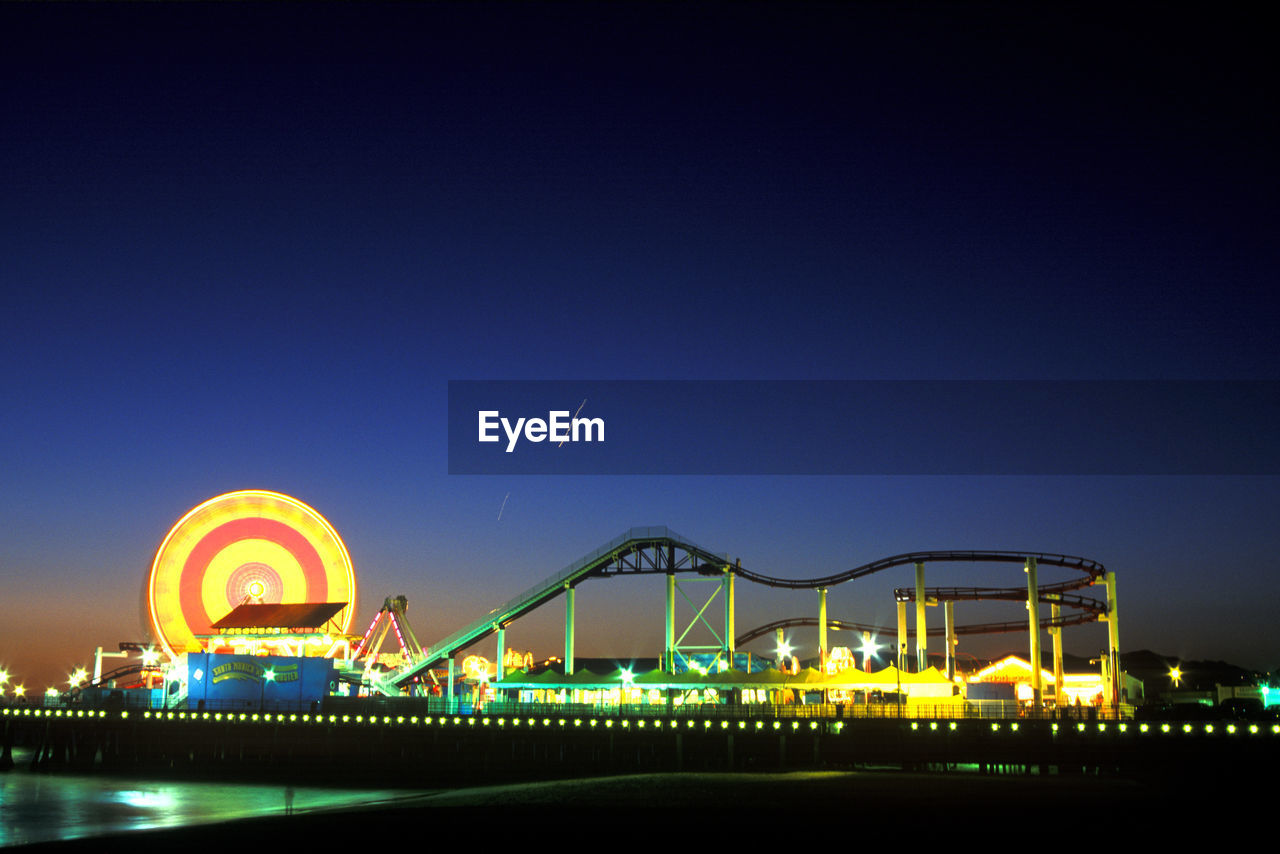 Illuminated Amusement Park At Night