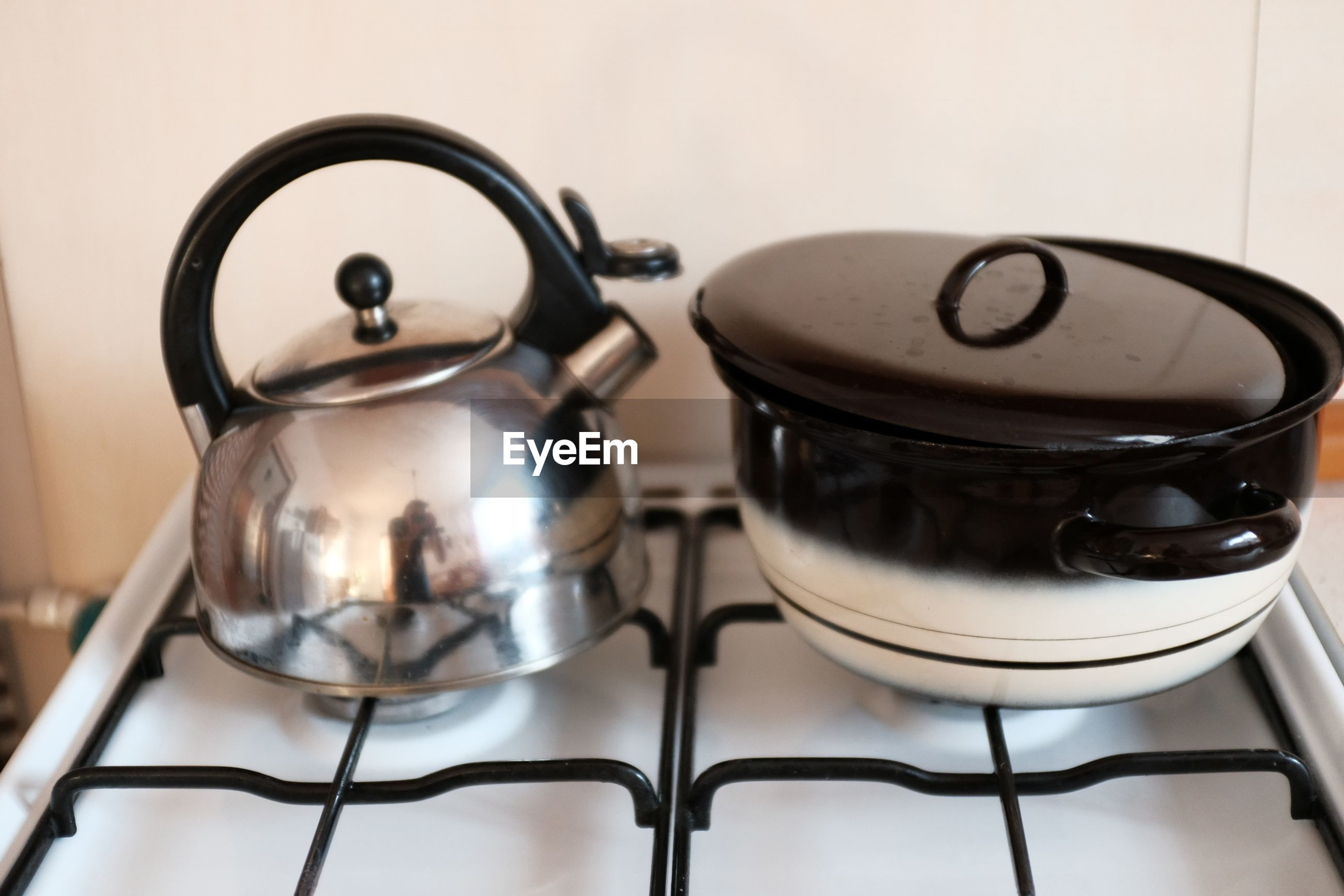 Kettle and container on stove at home