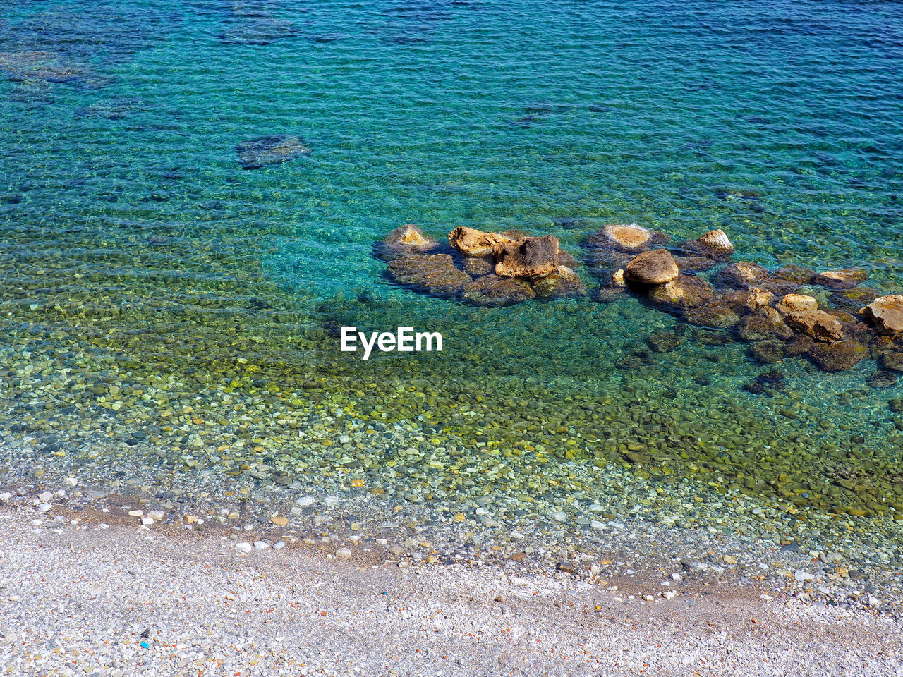 water, sea, nature, tranquility, beauty in nature, no people, day, tranquil scene, scenics - nature, land, high angle view, beach, blue, rock, animal wildlife, outdoors, underwater, solid, sea life, undersea, shallow, marine, turquoise colored