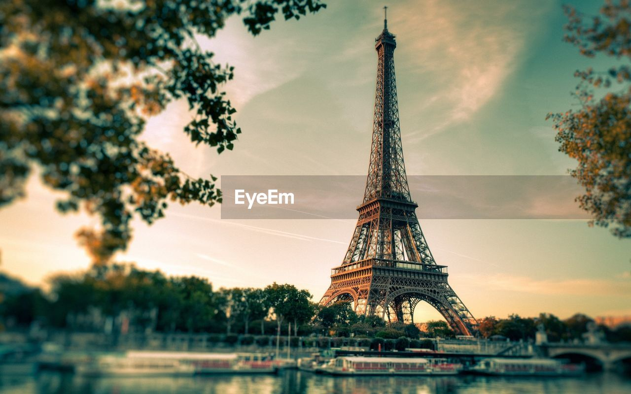 tower, sky, travel destinations, the past, history, city, architecture, tree, built structure, tourism, travel, tall - high, architectural feature, plant, nature, metal, cloud - sky, water, no people, outdoors, iron - metal, spire
