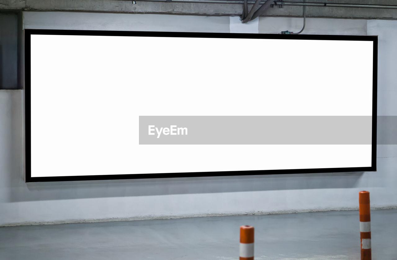Blank billboard against wall