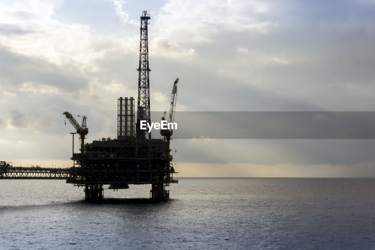 sky, industry, fuel and power generation, cloud - sky, oil industry, water, offshore platform, horizon over water, horizon, sea, drilling rig, oil, fossil fuel, nature, crude oil, waterfront, engineering, technology, outdoors, pollution