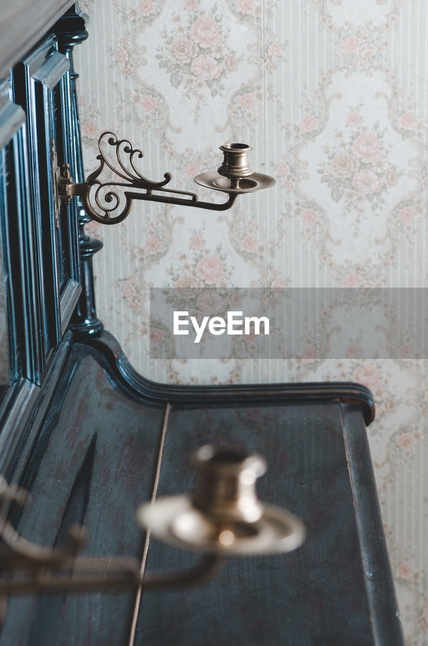 indoors, home, metal, no people, home interior, pattern, domestic room, wall - building feature, wallpaper, selective focus, design, floral pattern, house, lighting equipment, day, close-up, wealth, bedroom, hanging, bathroom, ornate, silver colored, luxury