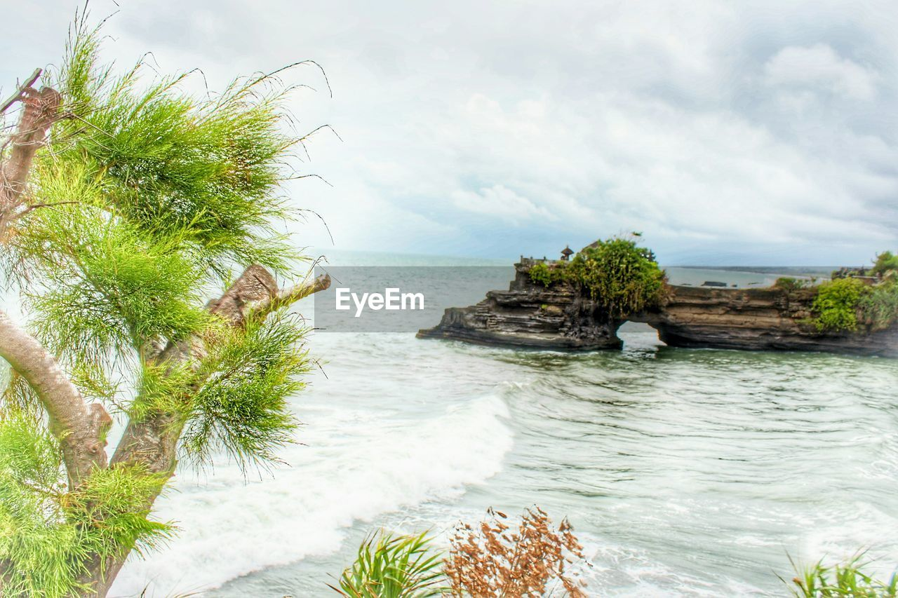 nature, sea, sky, rock - object, beauty in nature, water, scenics, tranquility, no people, horizon over water, day, outdoors, plant, tree