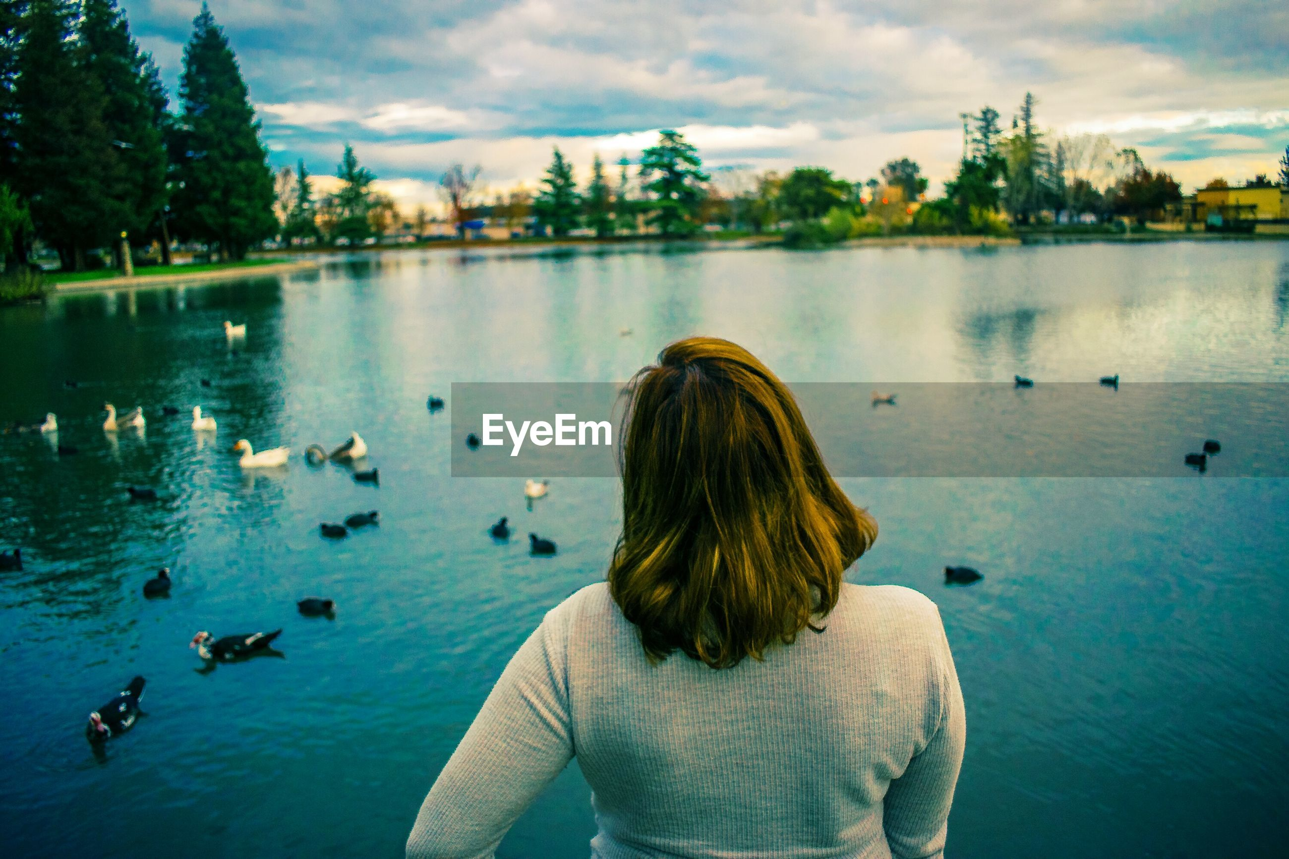 Young woman in front of lake
