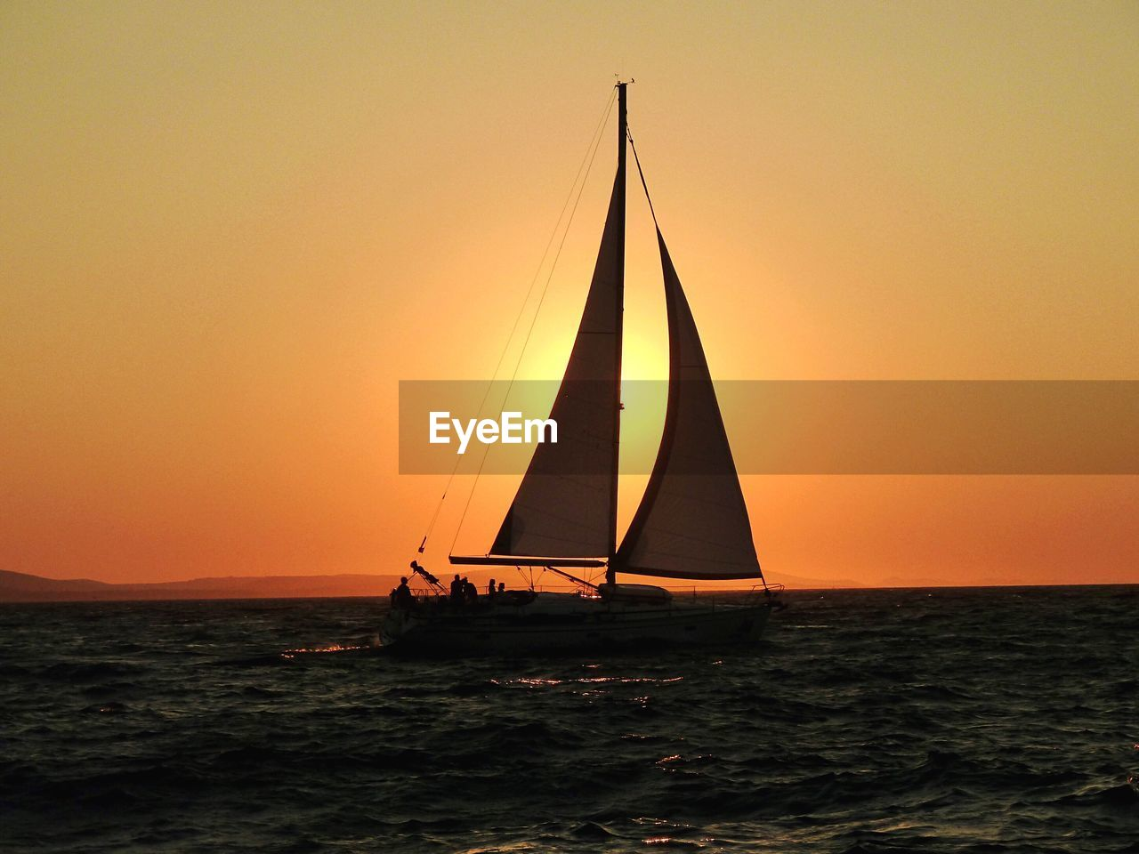sunset, sea, orange color, beauty in nature, silhouette, water, scenics, nature, nautical vessel, sailboat, tranquility, mast, transportation, clear sky, sky, outdoors, tranquil scene, horizon over water, waterfront, sailing, no people, day