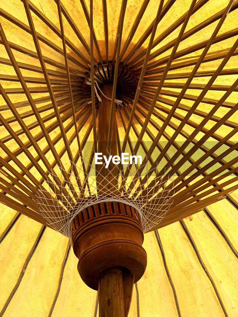 low angle view, pattern, no people, security, protection, day, umbrella, outdoors, sunlight, architecture, parasol, nature, close-up, shade, sunshade, safety, shadow, built structure, ceiling