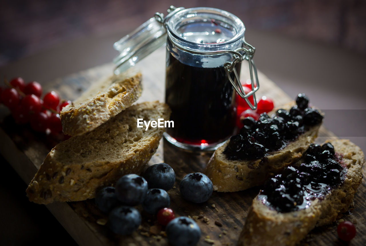 Breads with berry fruits on cutting board
