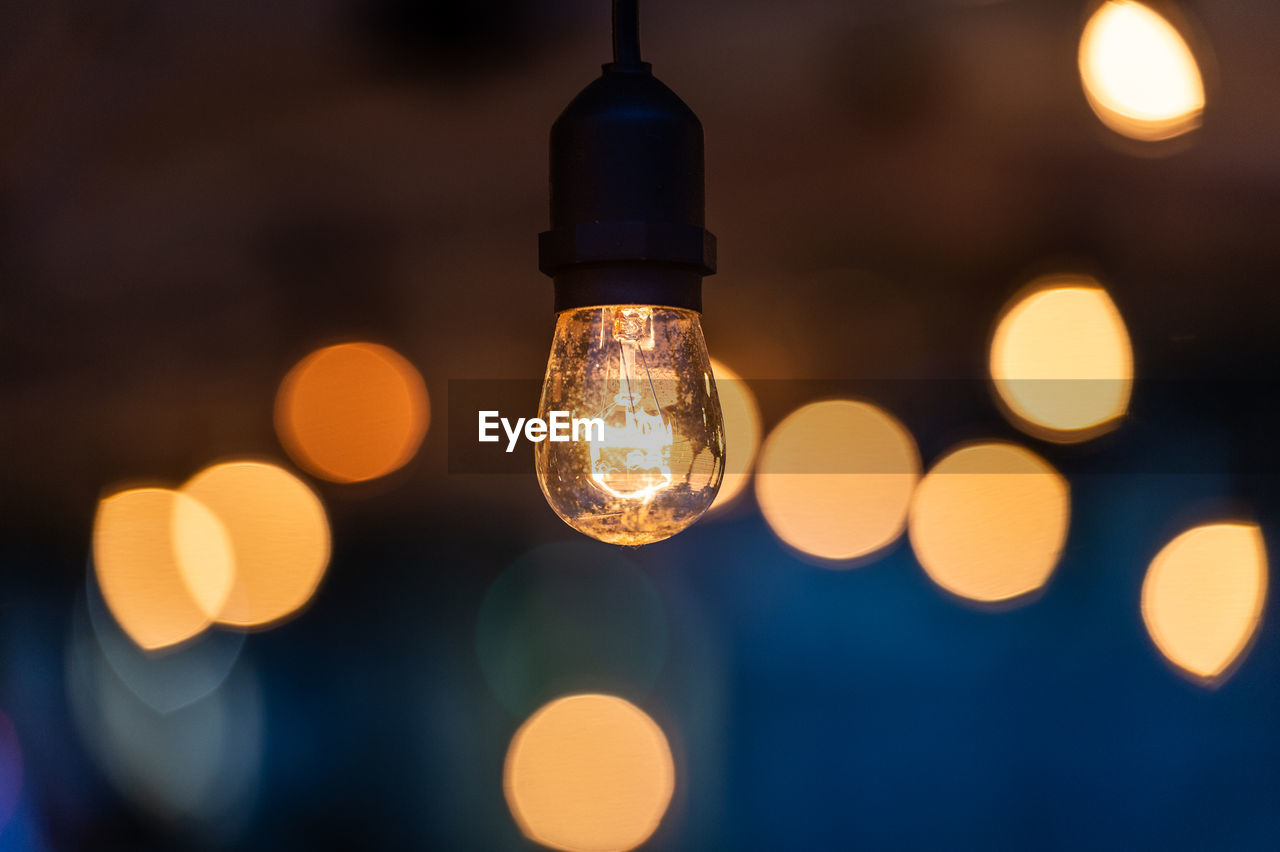 illuminated, lighting equipment, electricity, glowing, focus on foreground, electric light, light, light bulb, close-up, light - natural phenomenon, no people, technology, night, lens flare, decoration, glass - material, selective focus, connection, hanging, filament, electrical equipment, electric lamp