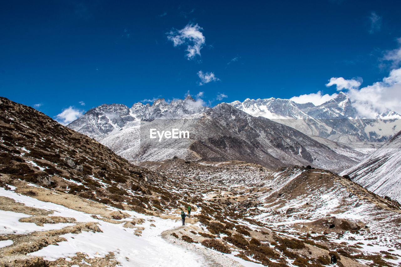 snow, mountain, winter, cold temperature, beauty in nature, nature, landscape, scenics, non-urban scene, snowcapped mountain, tranquil scene, tranquility, mountain range, weather, sky, outdoors, cloud - sky, day, physical geography, blue, no people, range