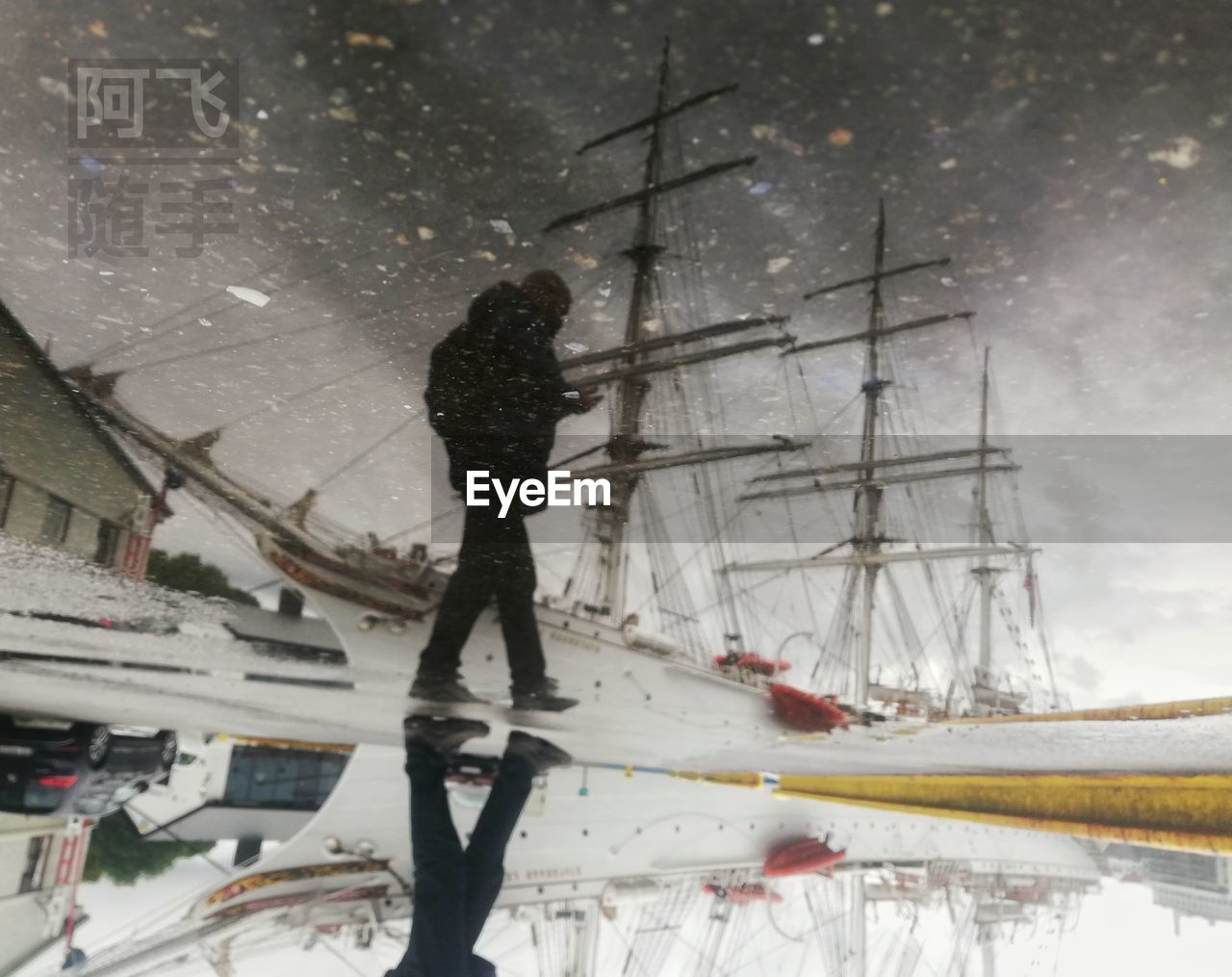 transportation, mode of transportation, nautical vessel, water, nature, one person, snow, real people, cold temperature, winter, travel, standing, full length, day, men, sky, outdoors, snowing, sailboat