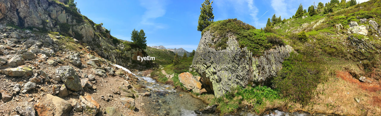 PANORAMIC VIEW OF ROCKS AND TREES AGAINST SKY