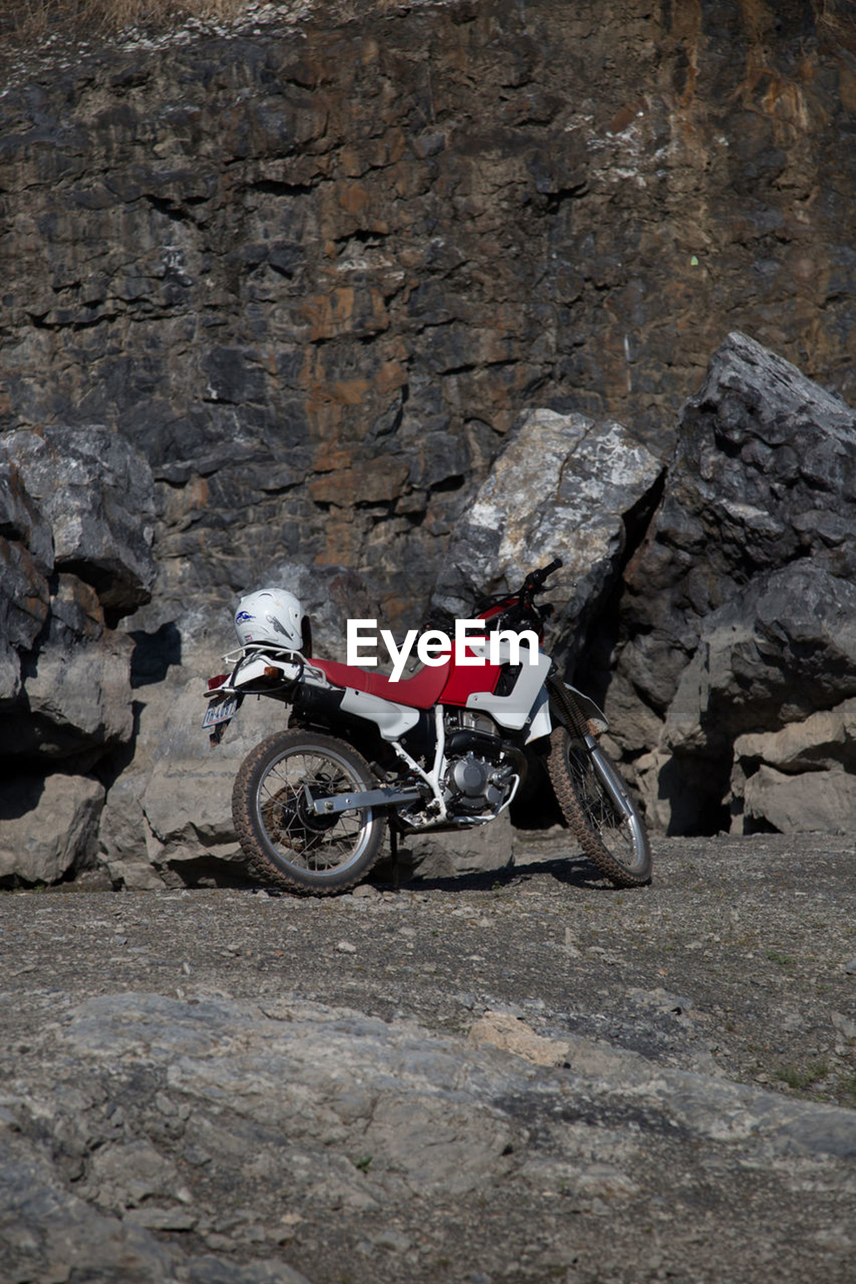 rock - object, motorcycle, adventure, day, outdoors, no people
