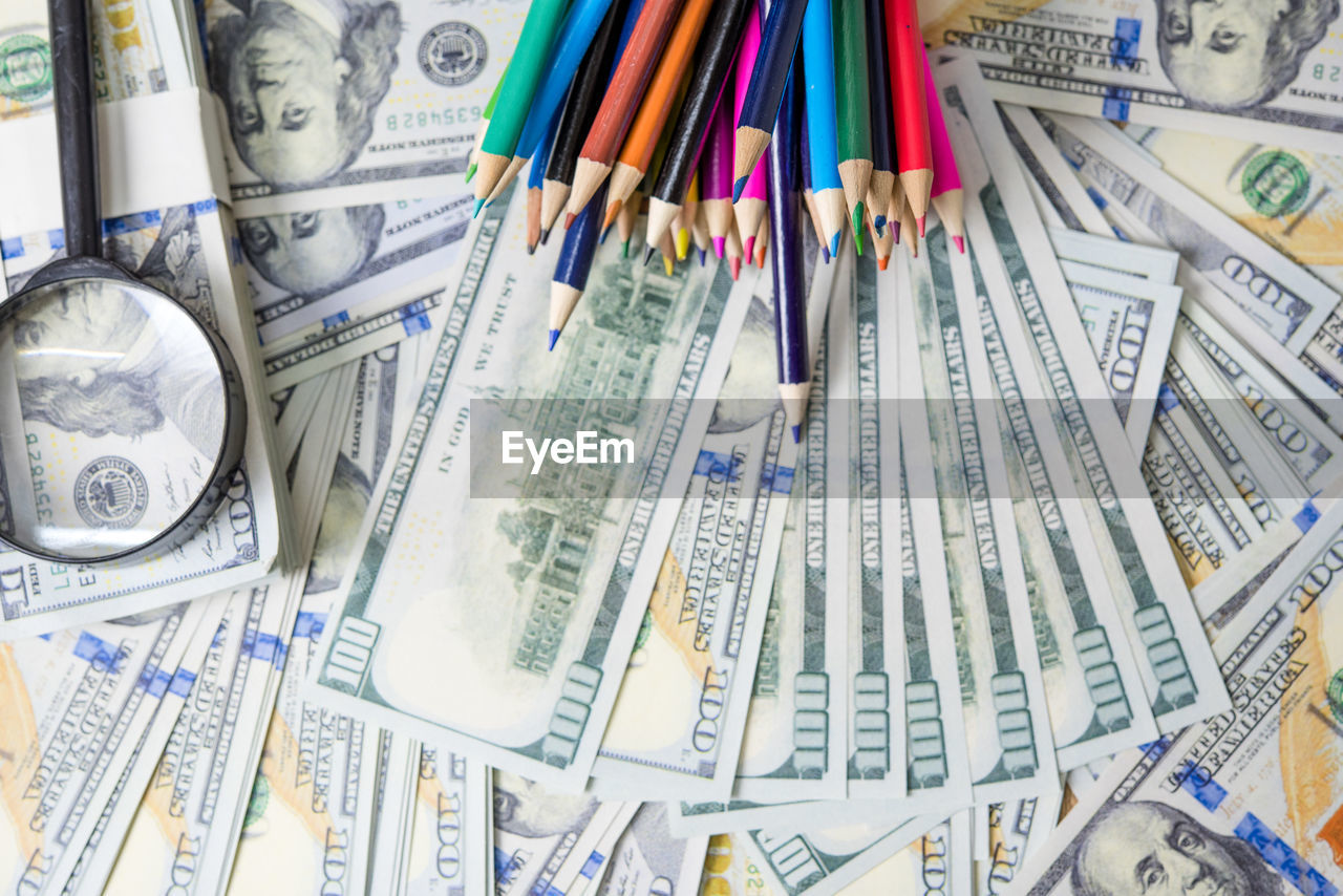 large group of objects, choice, multi colored, variation, no people, abundance, finance, paper currency, indoors, currency, close-up, business, studio shot, still life, paper, collection, wealth, art and craft, creativity, high angle view, consumerism