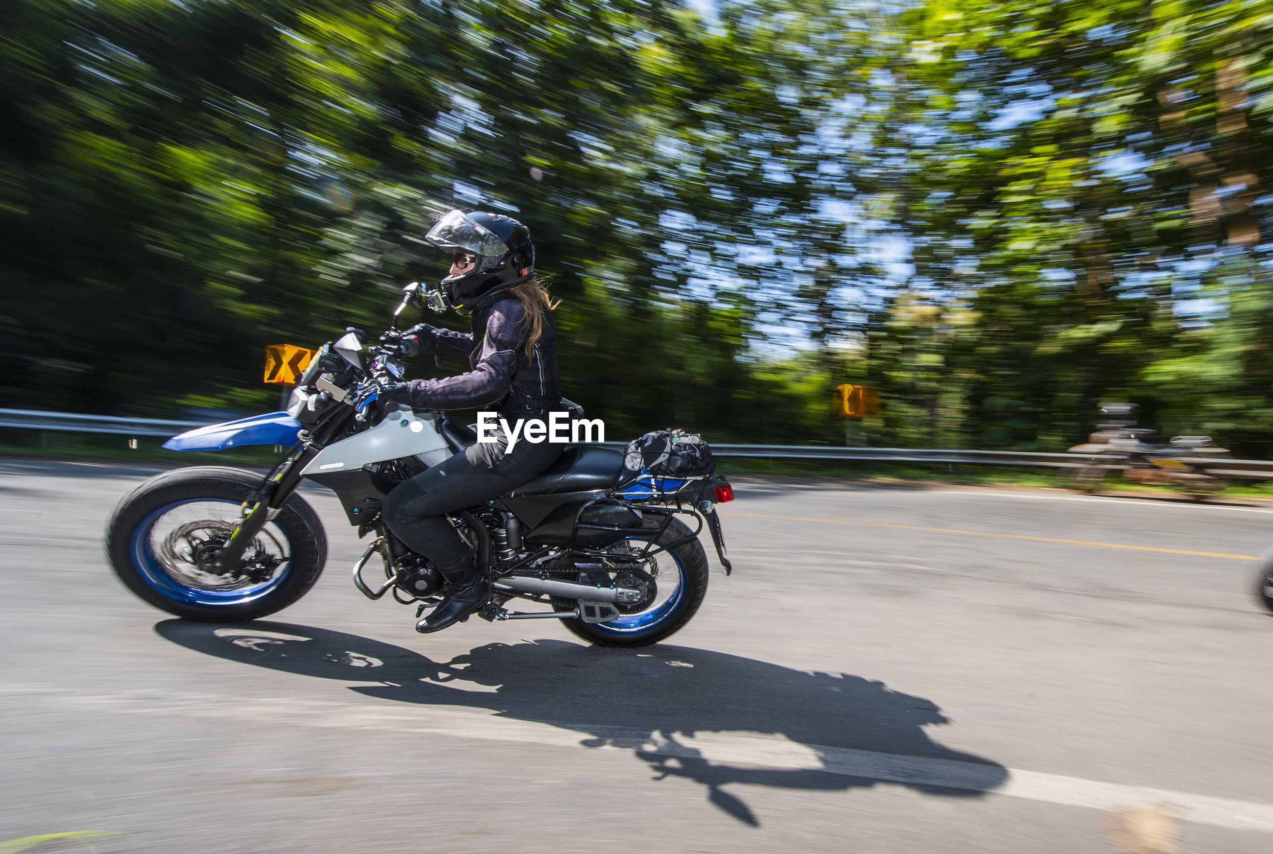 BICYCLES RIDING MOTORCYCLE ON ROAD