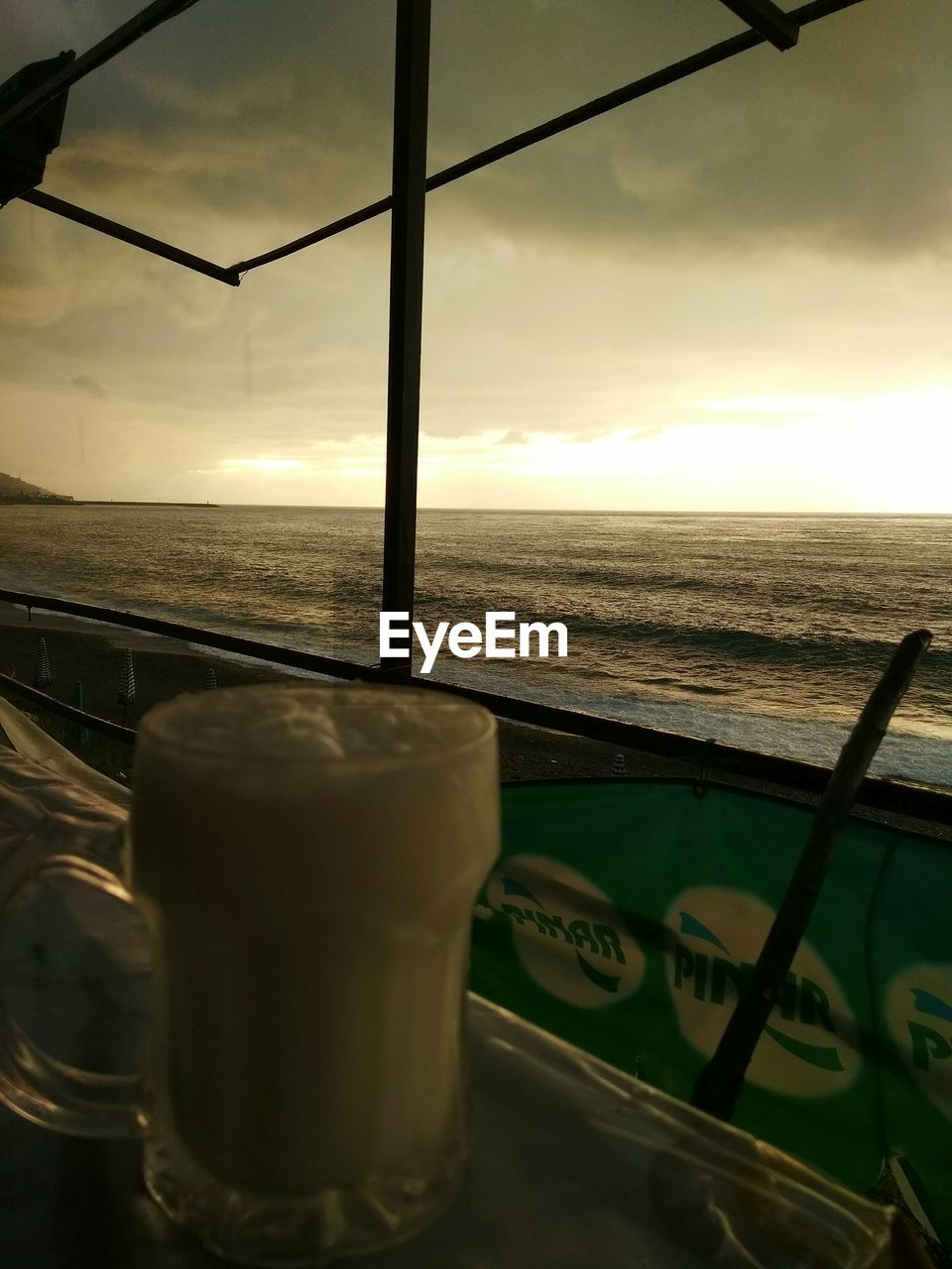 sea, sky, sunset, drink, no people, horizon over water, cloud - sky, nature, water, food and drink, table, beauty in nature, scenics, close-up, indoors, food, day, freshness