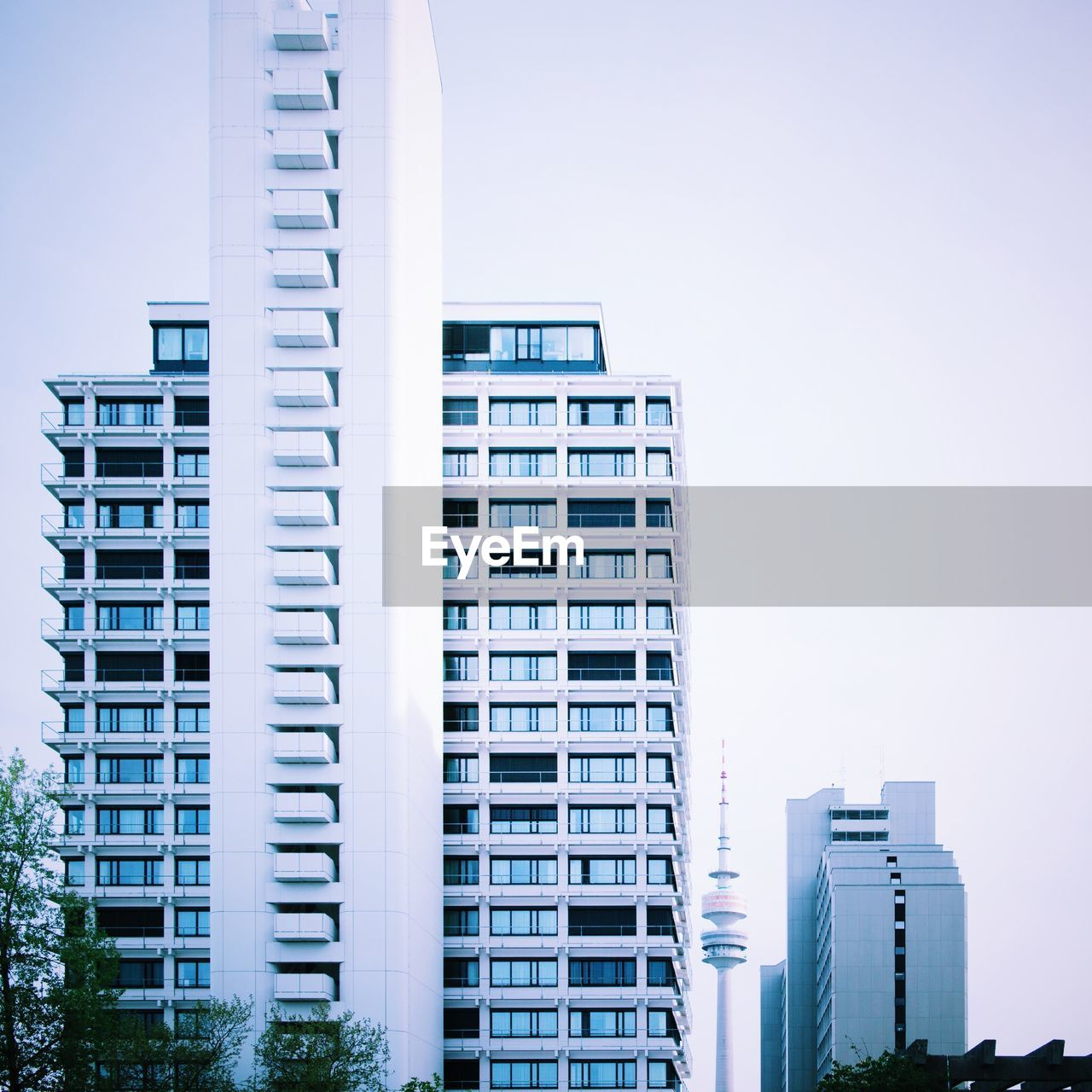architecture, building exterior, built structure, skyscraper, modern, city, outdoors, low angle view, day, clear sky, no people, sky