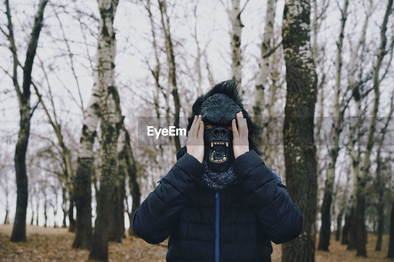 Person Wearing Mask In Forest
