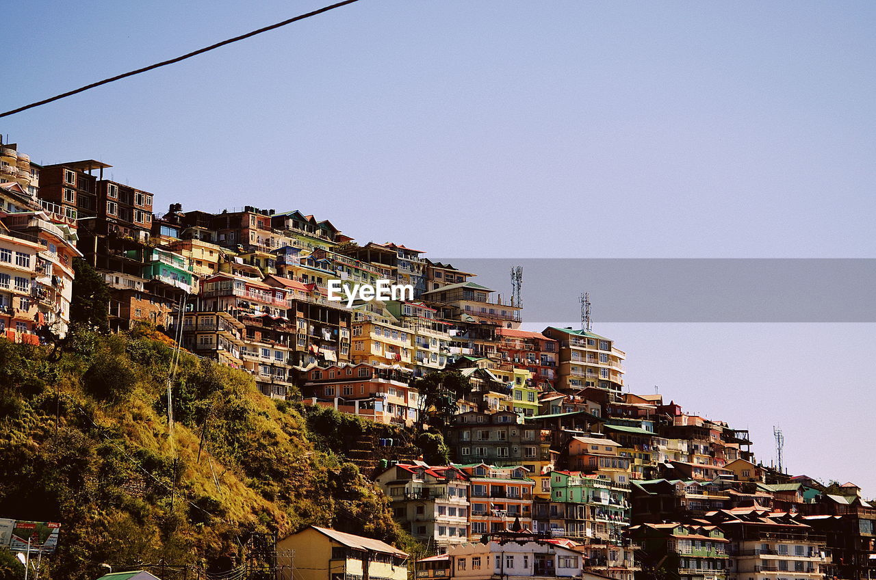 Low Angle View Of Town Against Clear Sky