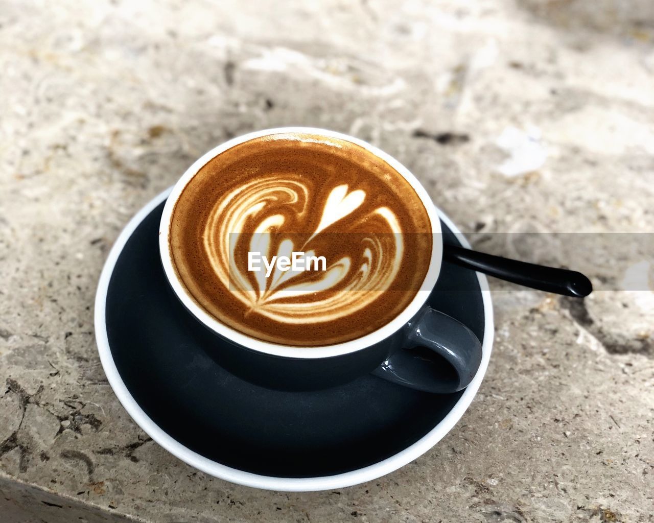 coffee, coffee - drink, drink, coffee cup, refreshment, cup, mug, food and drink, still life, cappuccino, crockery, saucer, frothy drink, hot drink, froth art, high angle view, freshness, table, spoon, close-up, latte, no people, non-alcoholic beverage, froth, caffeine