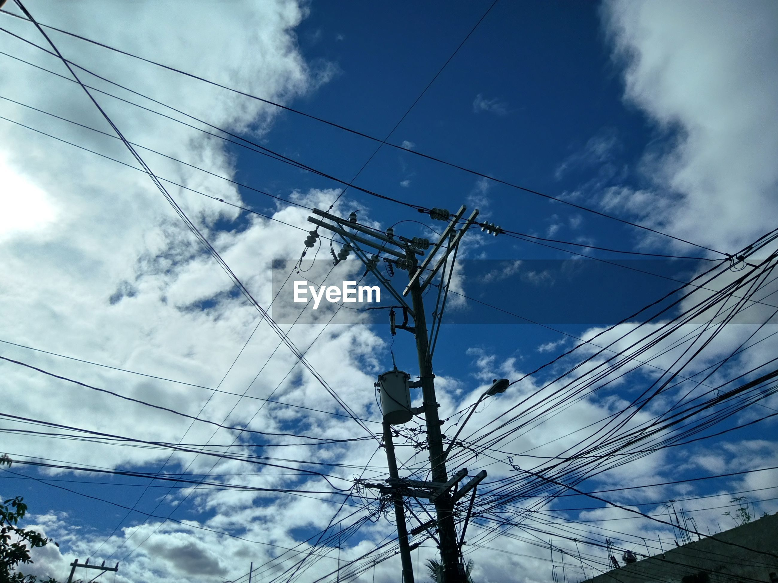 power supply, electricity, cable, power line, connection, sky, fuel and power generation, low angle view, cloud - sky, electricity pylon, technology, complexity, no people, electric pole, outdoors, day, electricity tower, nature, telephone line