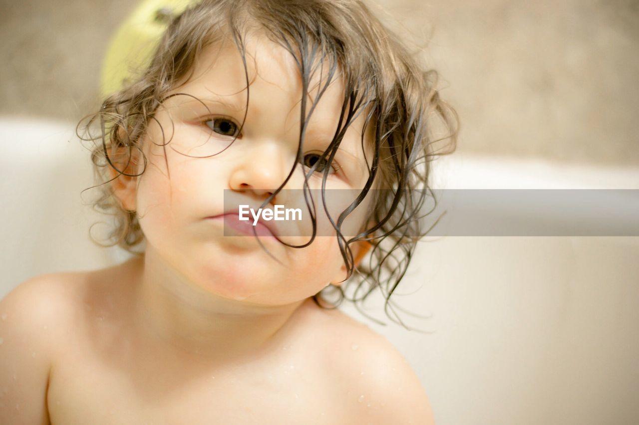 Close-Up Of Baby Girl Having Bath At Home