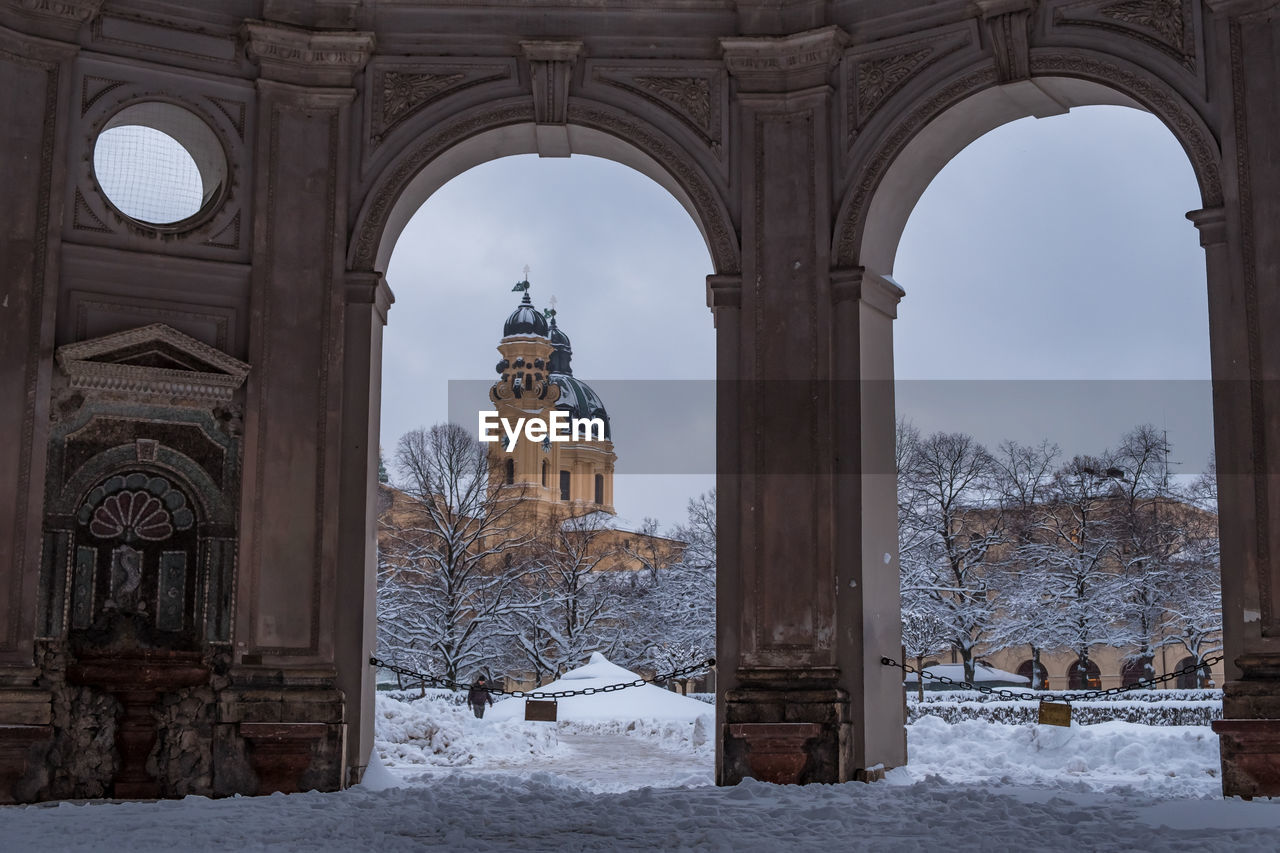 Cathedral in city seen through doorway during winter