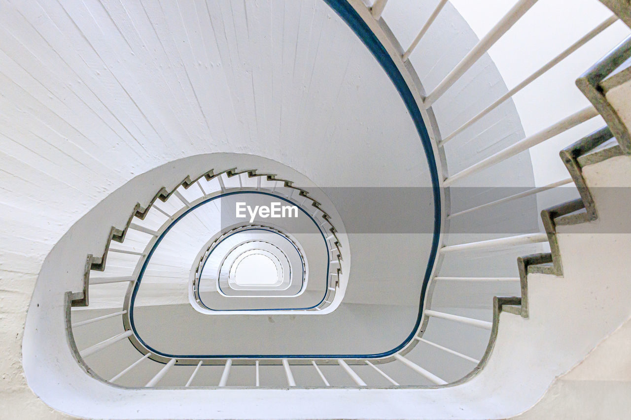 staircase, steps and staircases, architecture, built structure, spiral, spiral staircase, railing, indoors, no people, pattern, white color, diminishing perspective, high angle view, day, design, directly below, directly above, absence, building, building feature