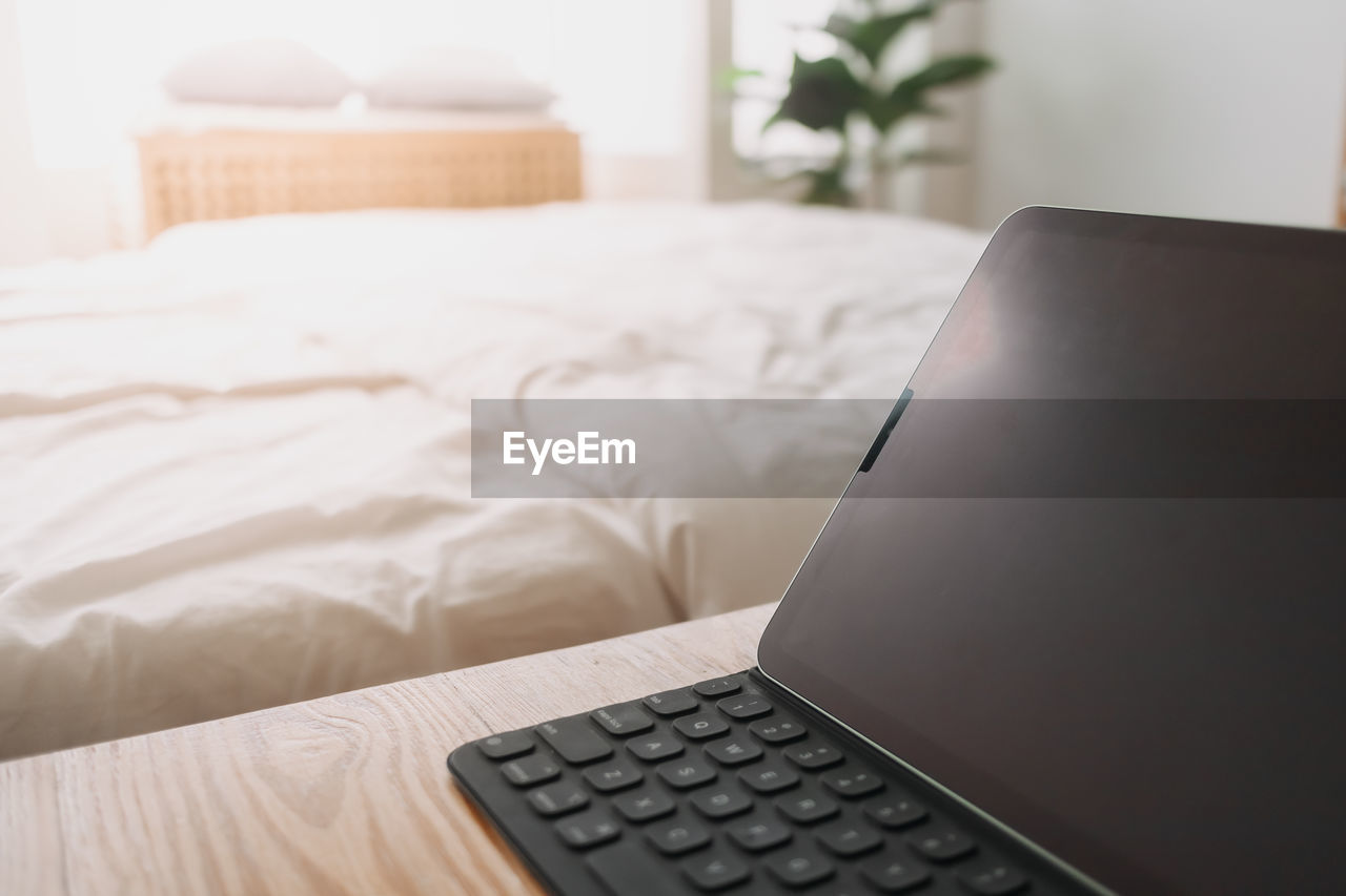 CLOSE-UP OF LAPTOP ON TABLE