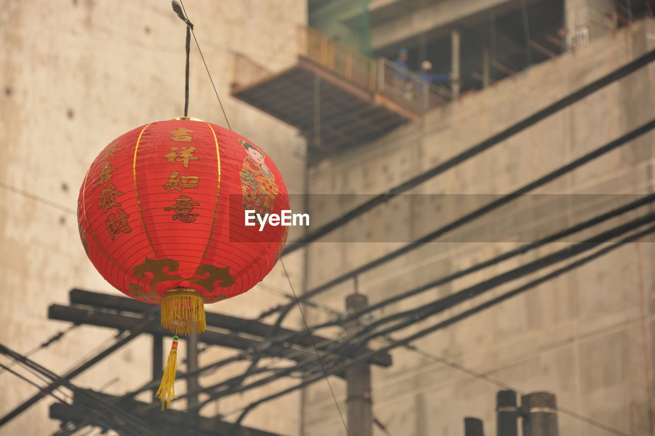 hanging, lantern, chinese lantern, focus on foreground, low angle view, red, lighting equipment, decoration, architecture, no people, built structure, celebration, event, chinese new year, outdoors, day, nature, festival, chinese lantern festival