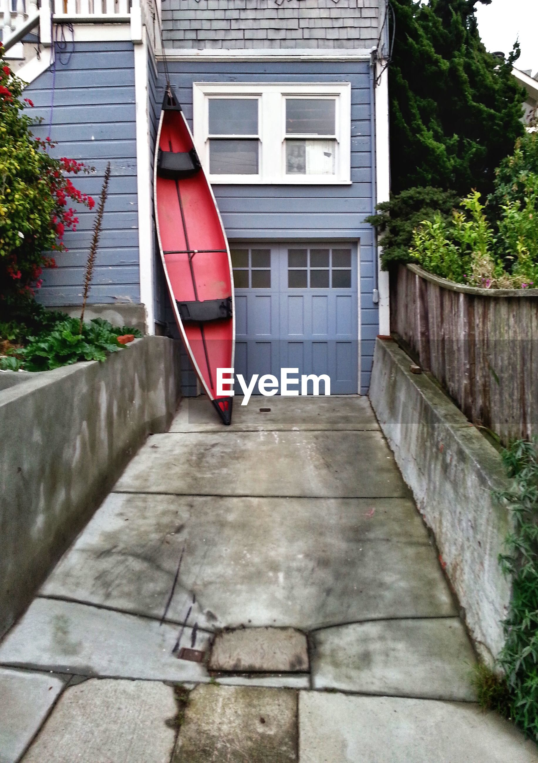 Boat leaning on house wall