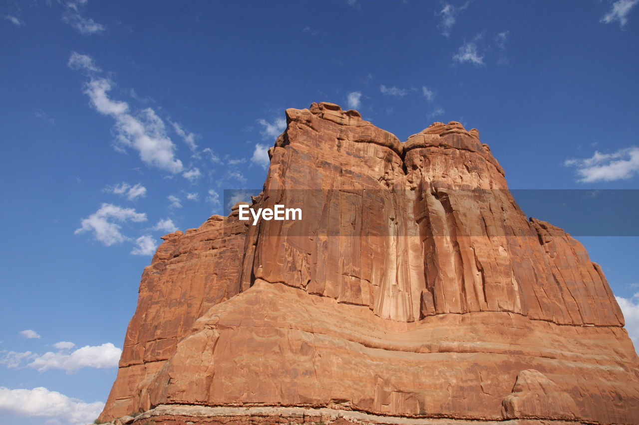 sky, cloud - sky, low angle view, rock formation, rock, nature, solid, rock - object, no people, day, travel, sunlight, travel destinations, tourism, beauty in nature, tranquility, architecture, physical geography, outdoors, tranquil scene, formation, eroded, arid climate