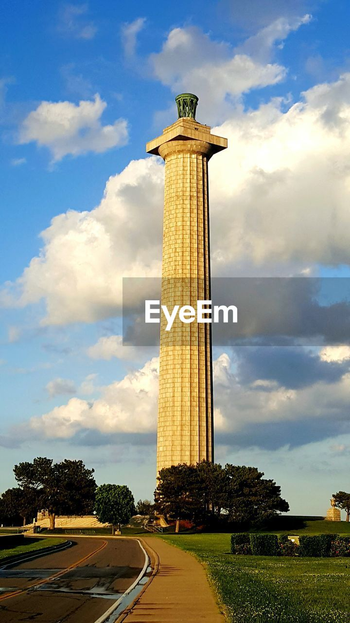 cloud - sky, sky, architecture, travel destinations, architectural column, day, built structure, monument, tree, grass, outdoors, no people, nature