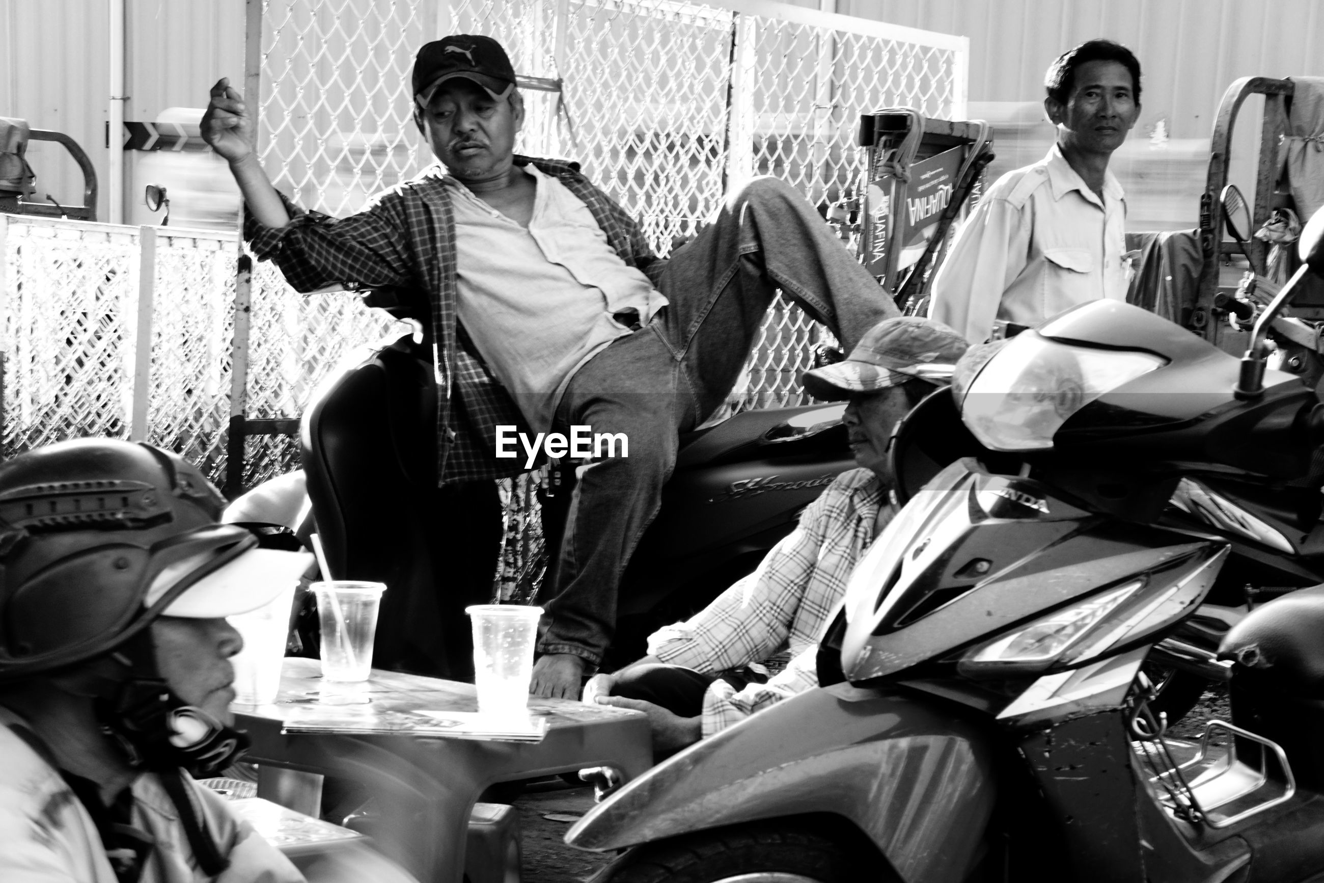 PEOPLE SITTING ON CHAIR AT MARKET