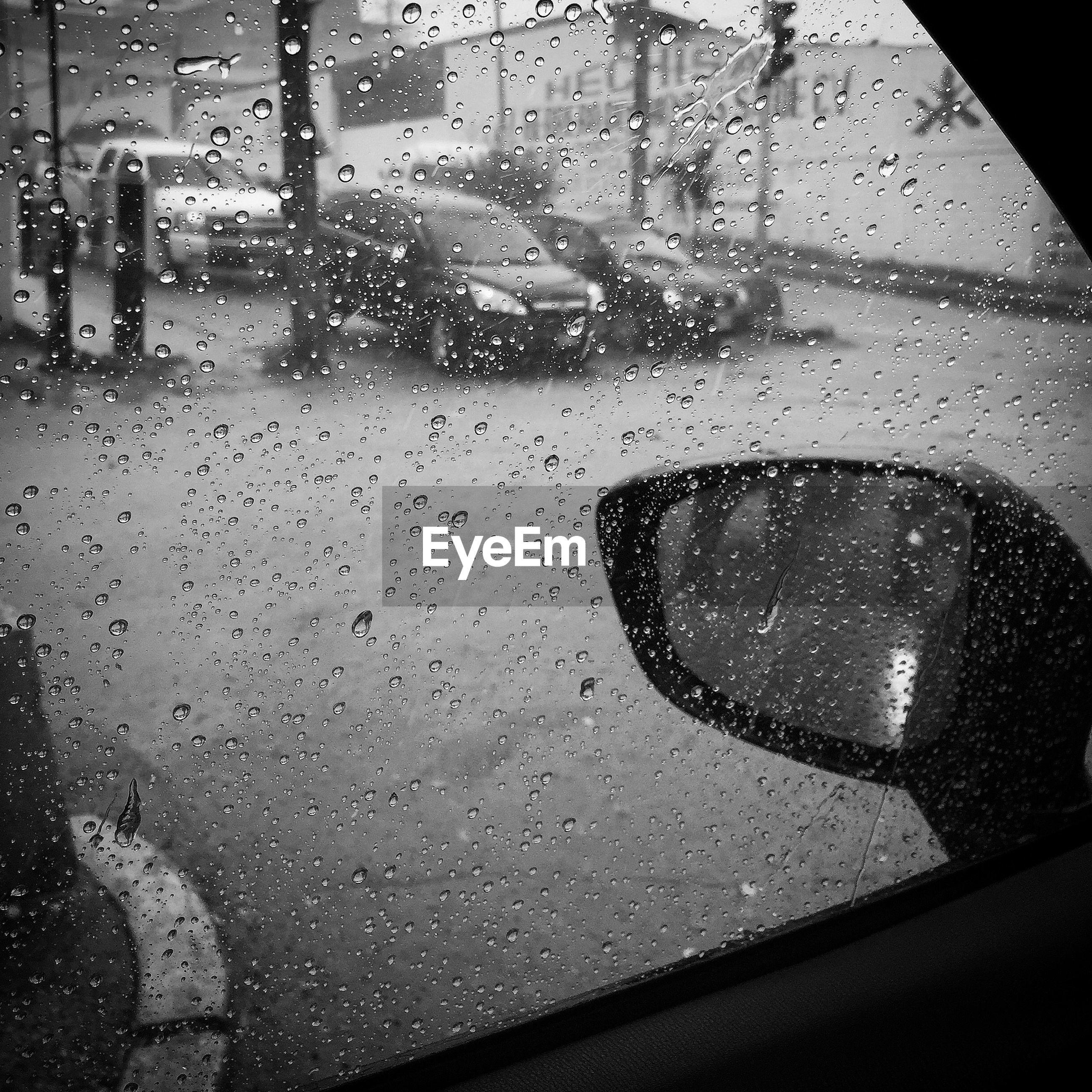 drop, wet, water, glass - material, window, transparent, indoors, rain, raindrop, season, glass, close-up, weather, car, monsoon, vehicle interior, rainy, looking through window, day, reflection
