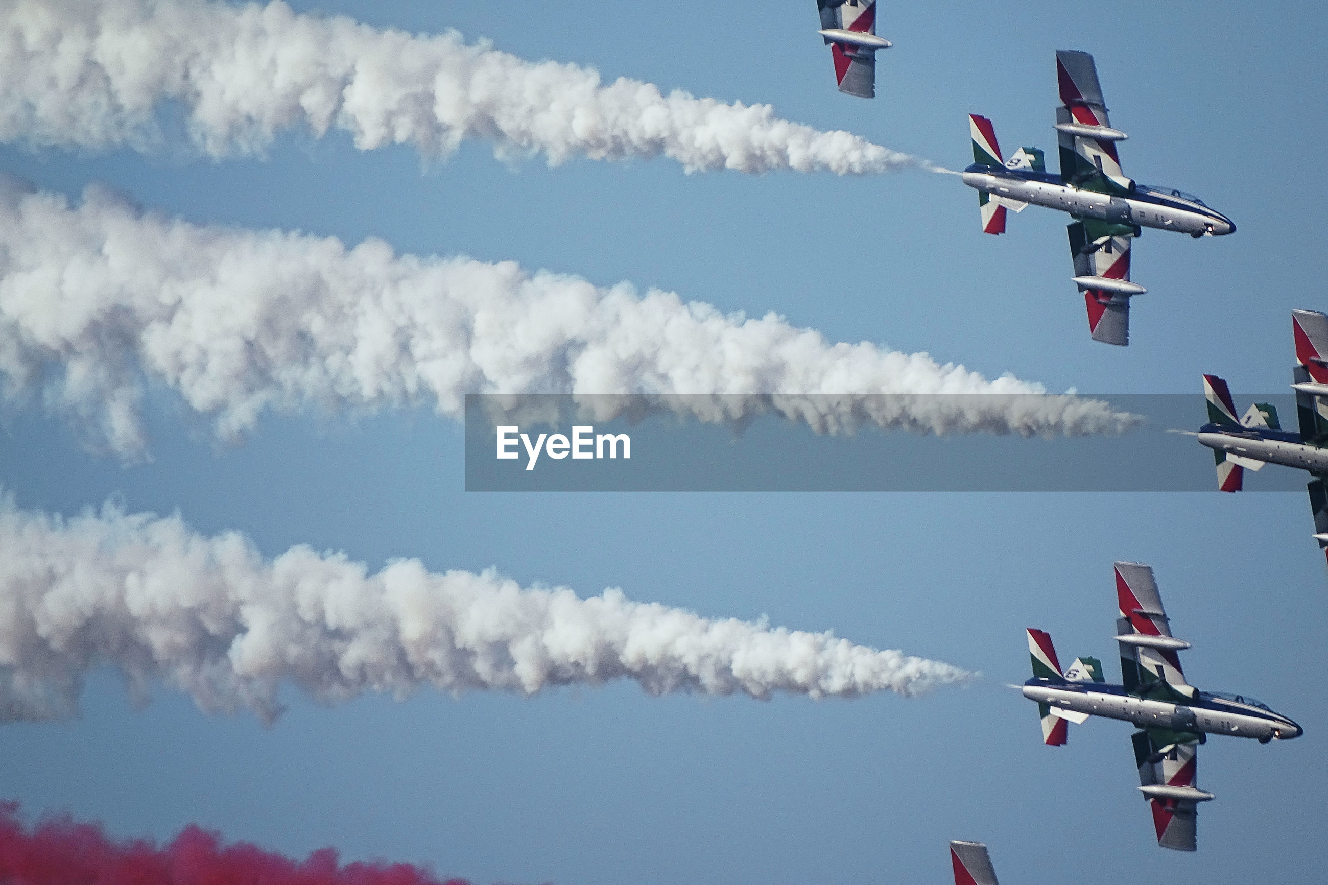 Aerial view of airplane flying in sky during airshow