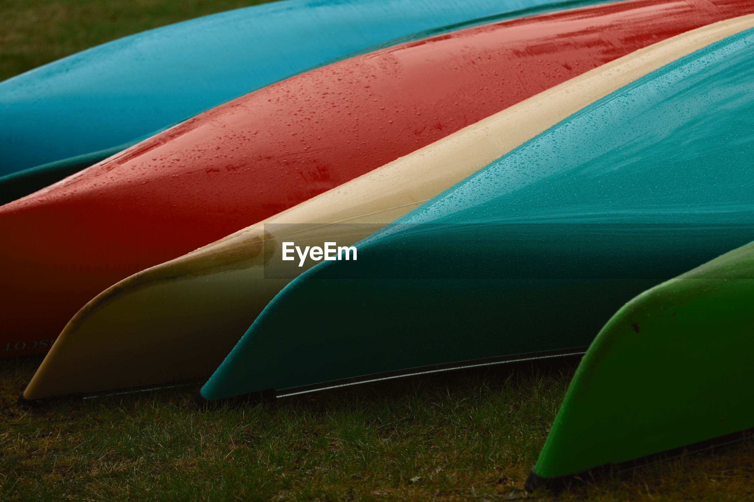Colorful boats on field