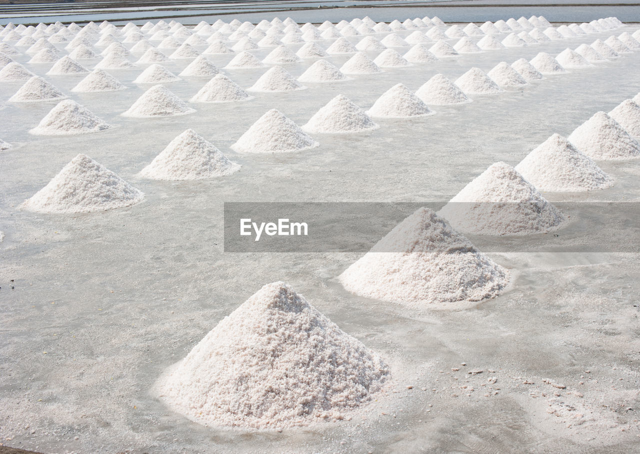 mineral, heap, salt - mineral, no people, nature, salt flat, day, white color, sand, land, pyramid shape, industry, rock, outdoors, solid, mining, backgrounds, large group of objects, gravel, full frame, pebble